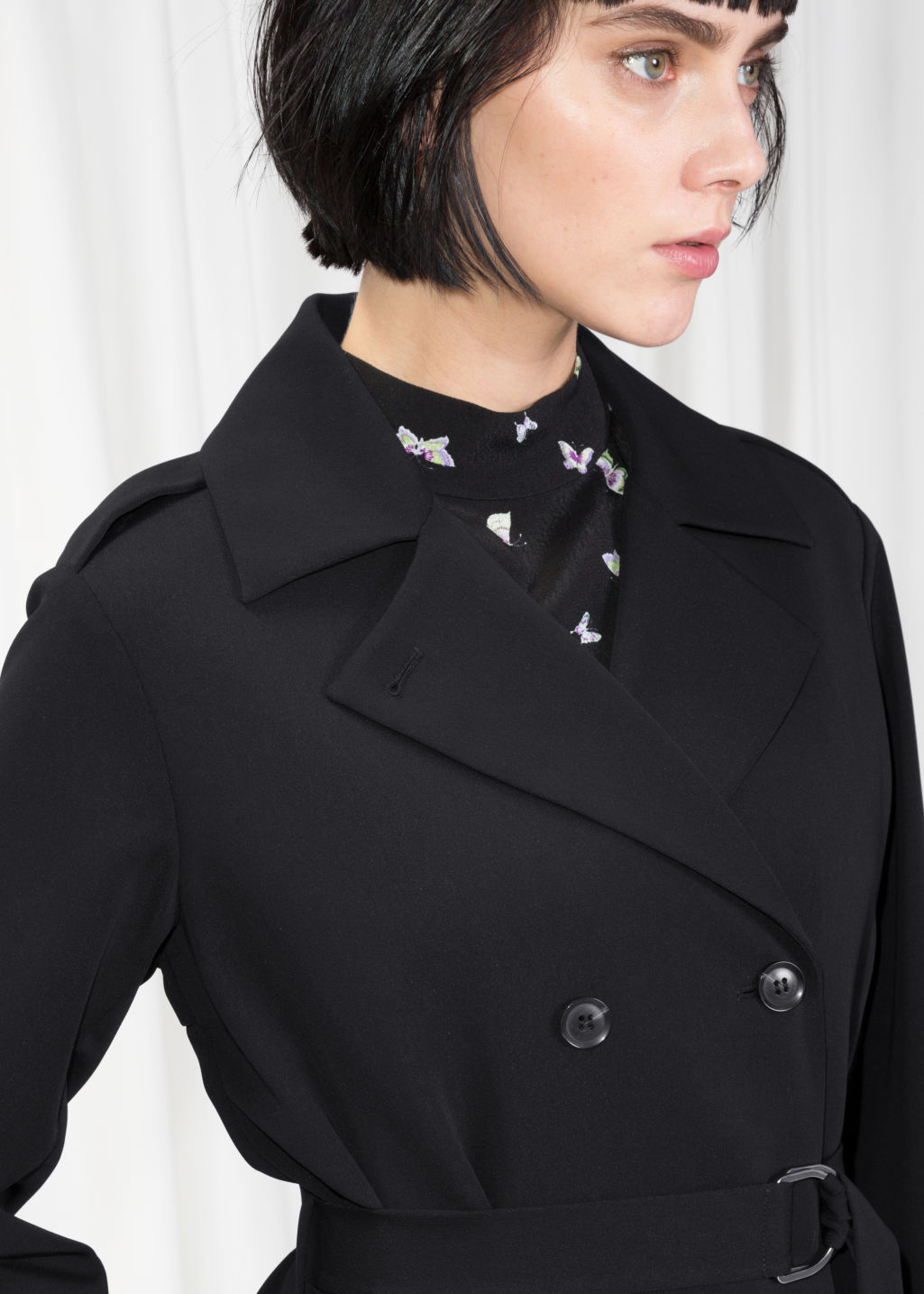 Detailed image of Stories double breasted trench coat in black