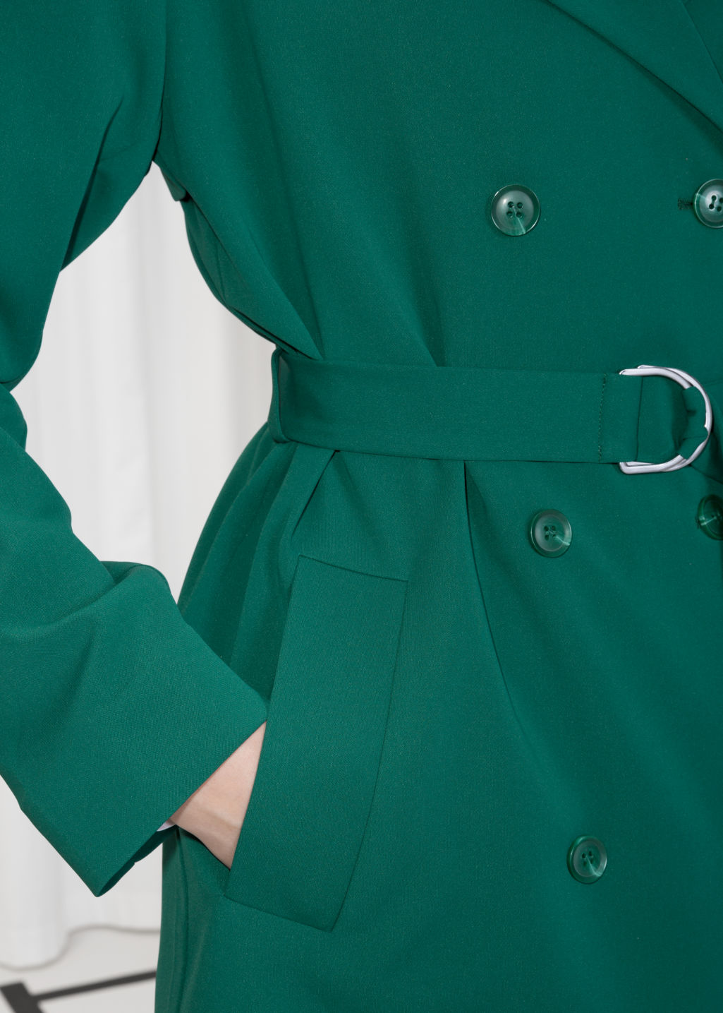 Detailed image of Stories double breasted trench coat in green