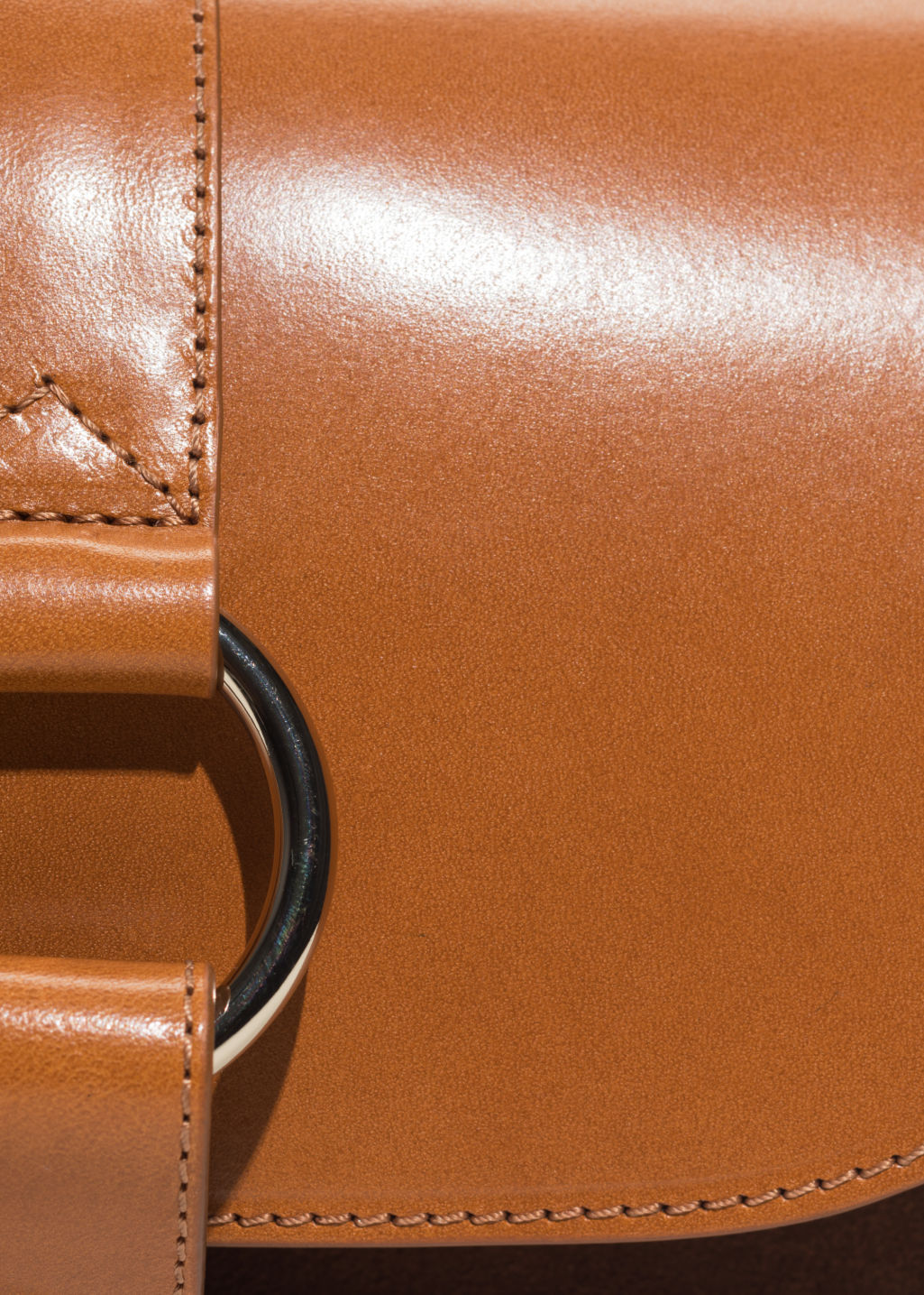 Detailed image of Stories leather crossover bag  in beige