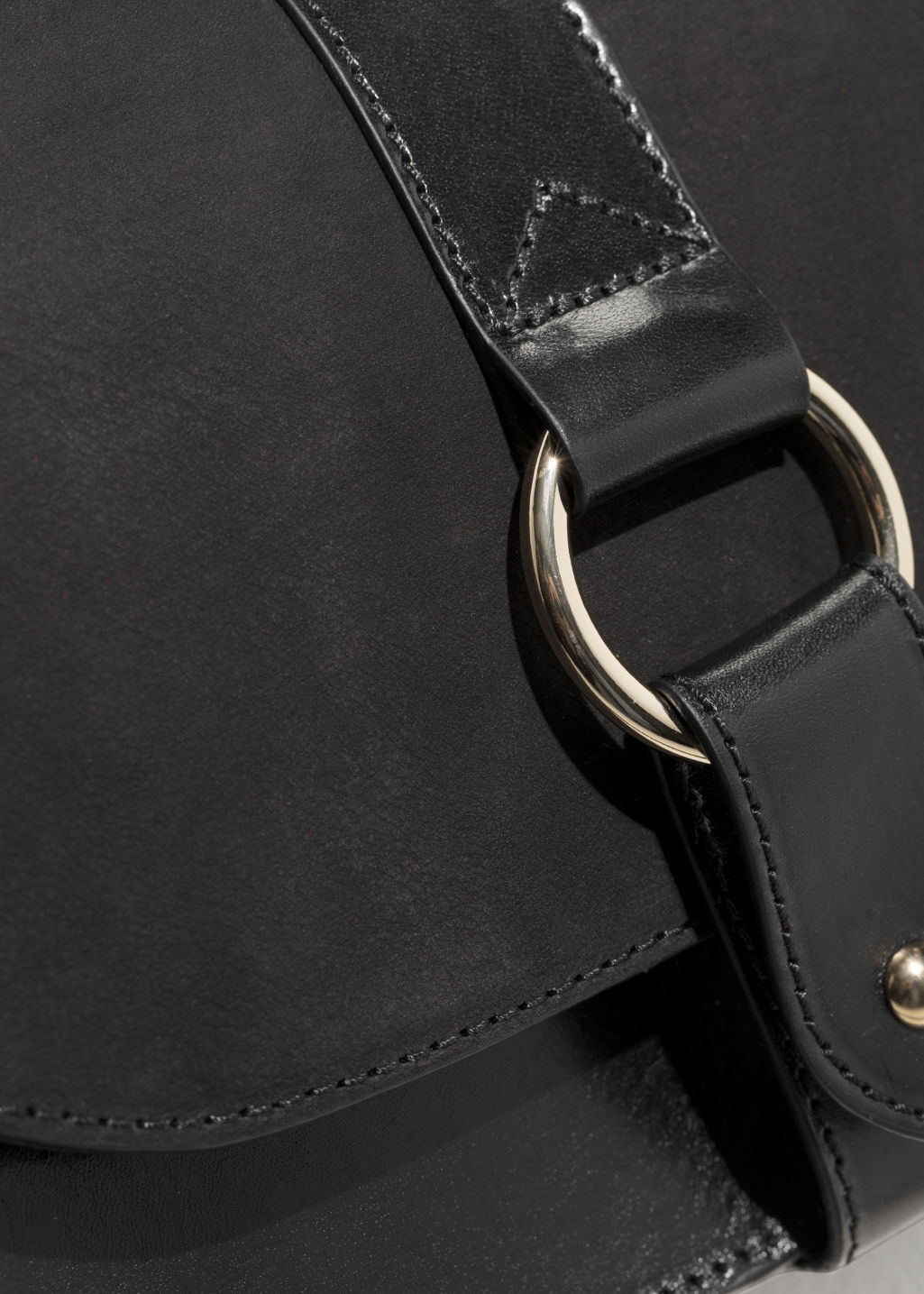 Detailed image of Stories leather crossover bag  in black