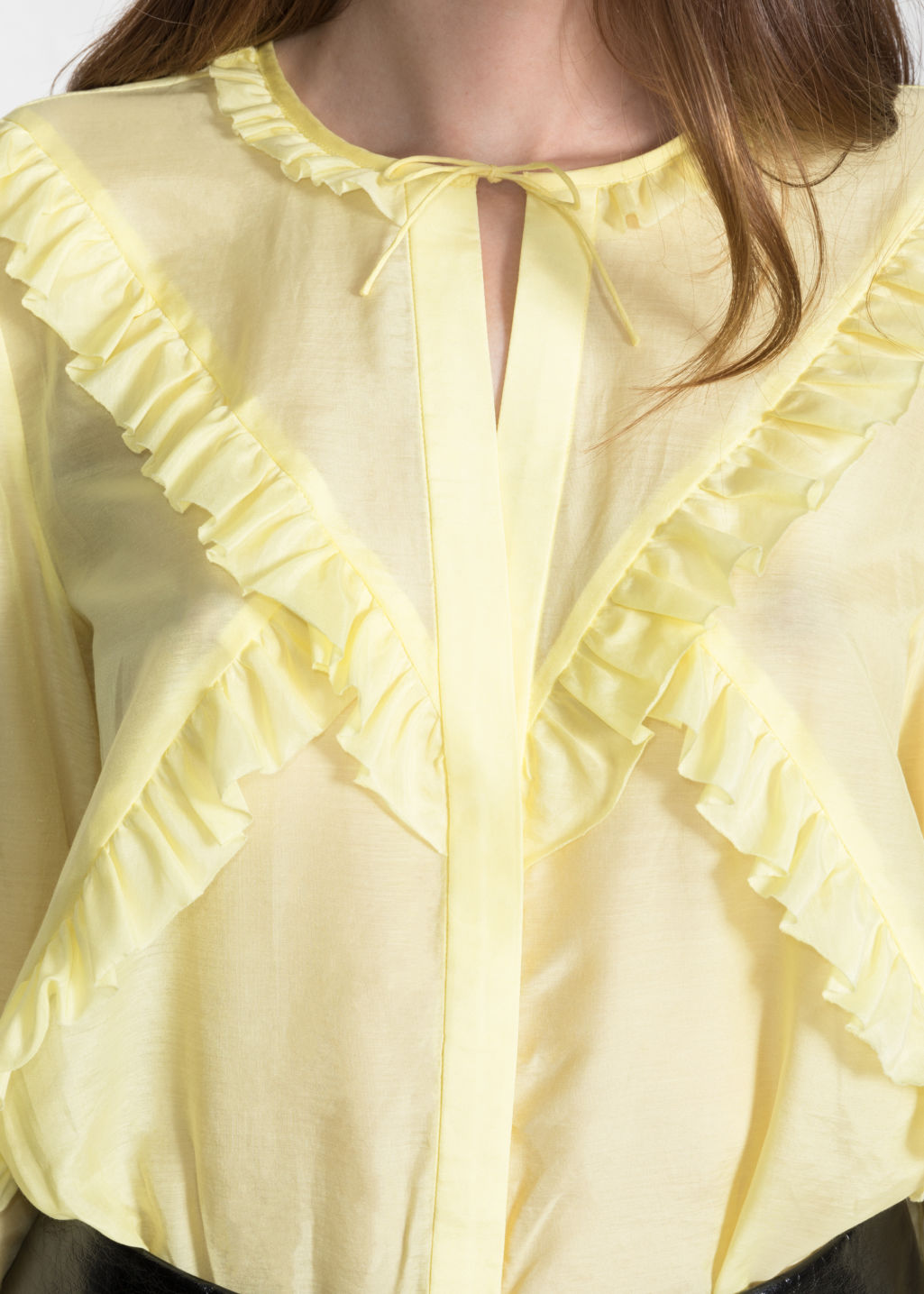 Detailed image of Stories flare sleeve frills shirt in yellow