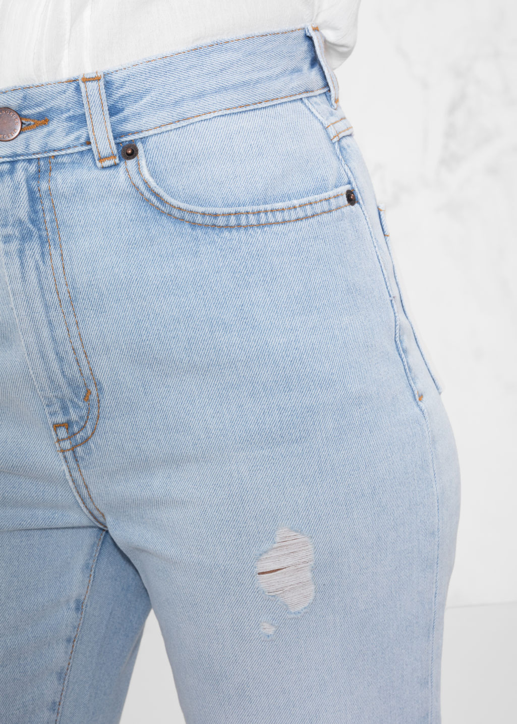 Detailed image of Stories ripped denim jeans in blue