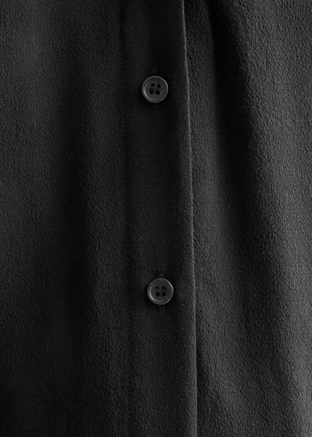Detailed image of Stories placket dress in black