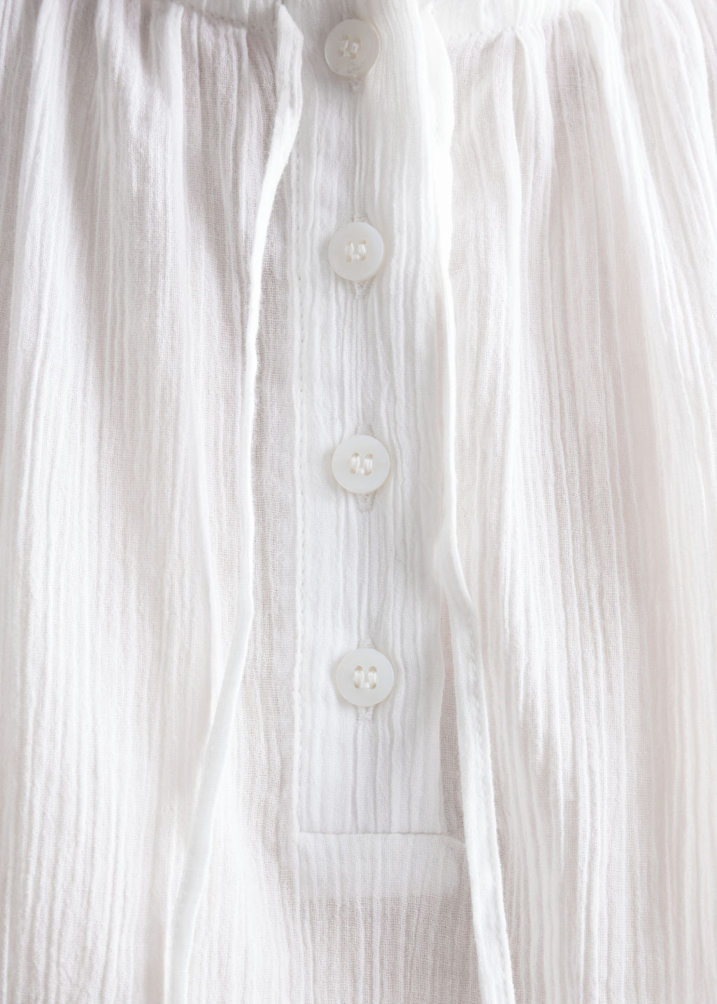 Detailed image of Stories frill sleeveles blouse in white
