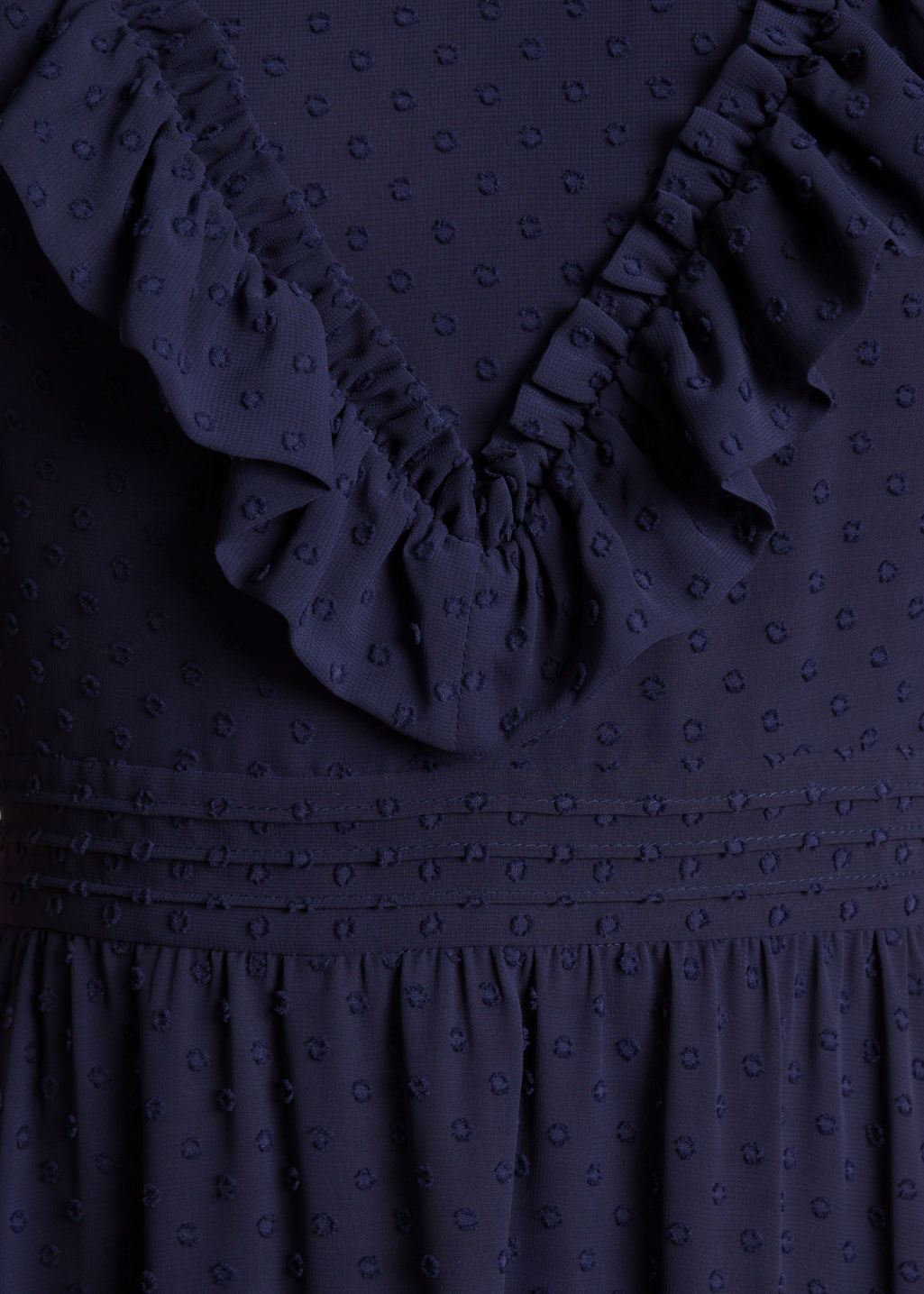 Detailed image of Stories open back dotted jacquard dress in blue