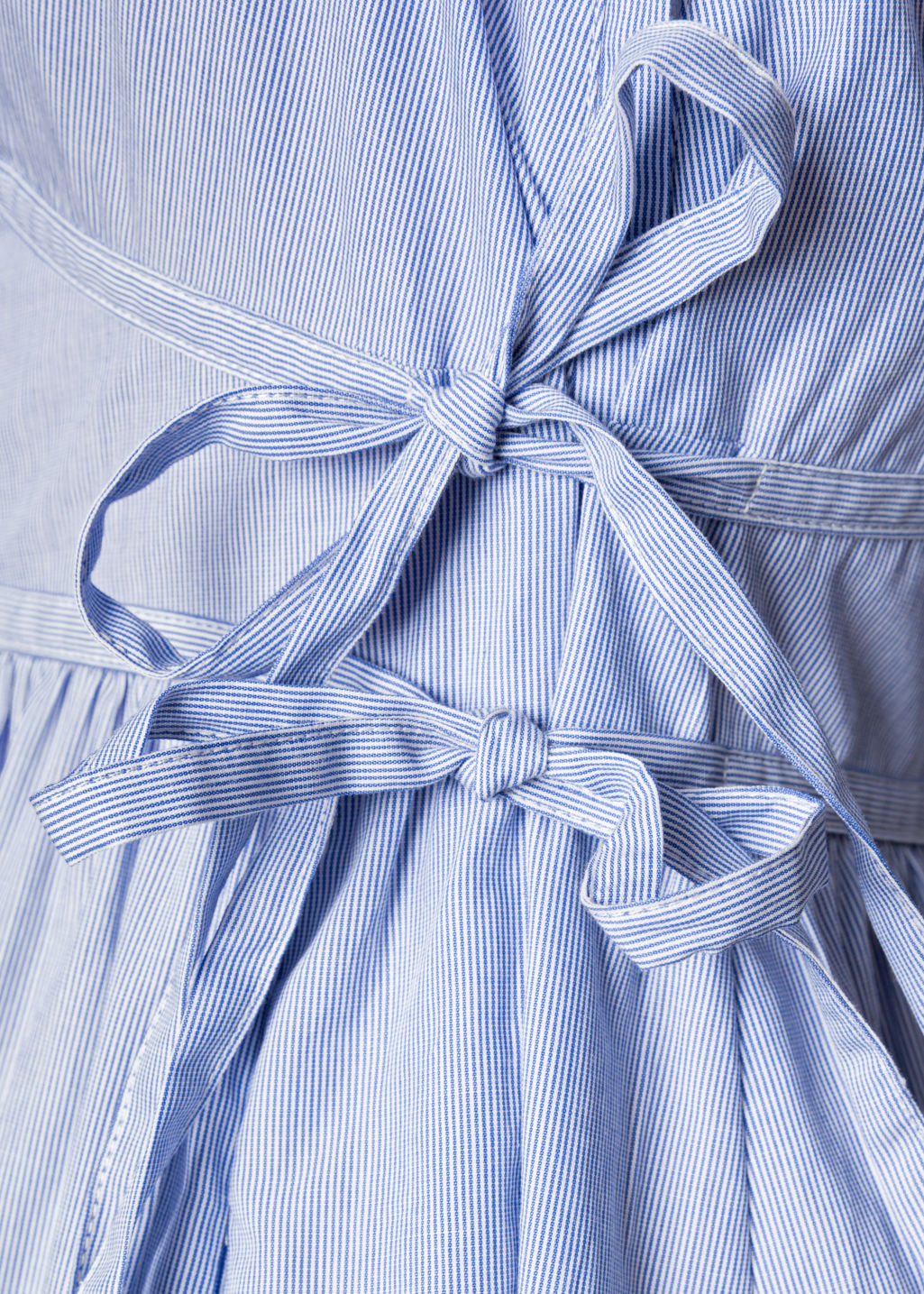 Detailed image of Stories frills and ties dress in blue