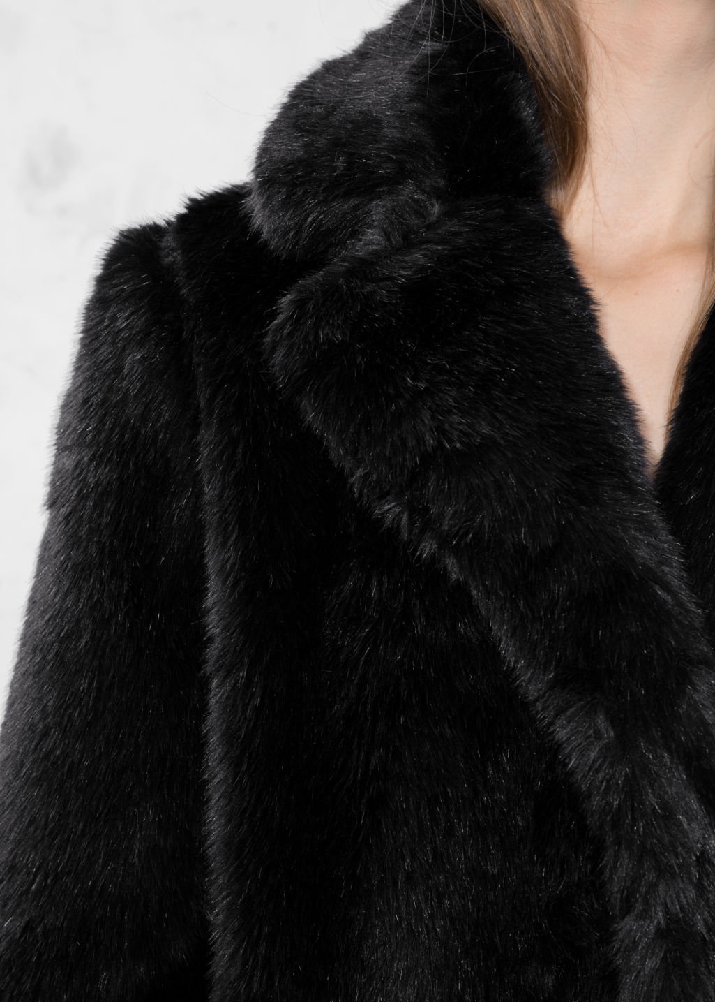 Detailed image of Stories faux fur jacket in black