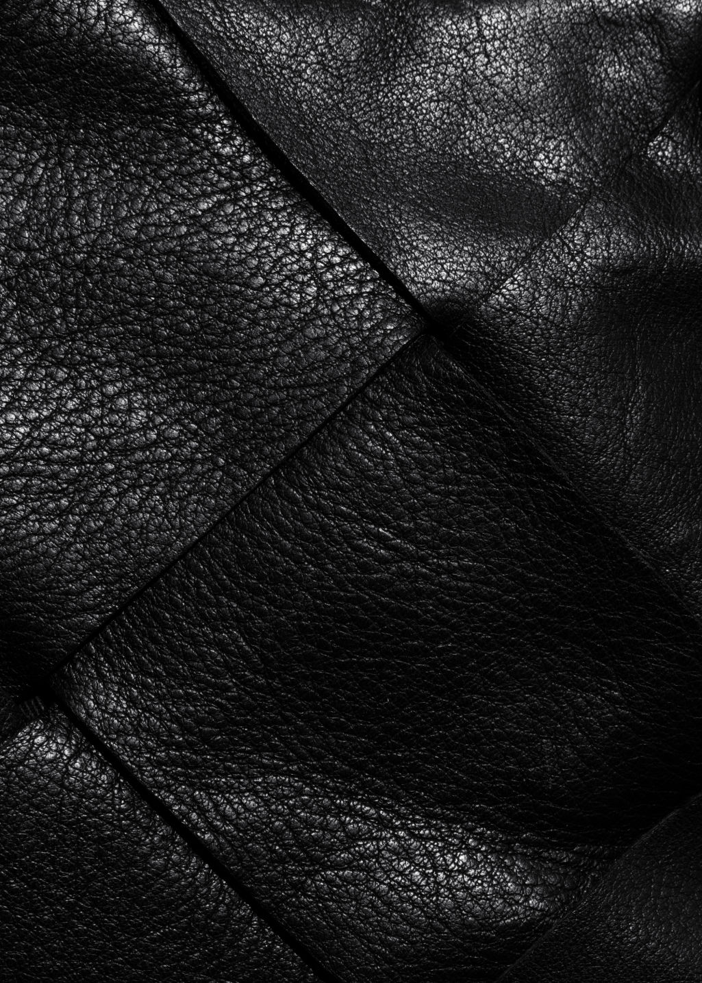 Detailed image of Stories braided leather crossbody in black