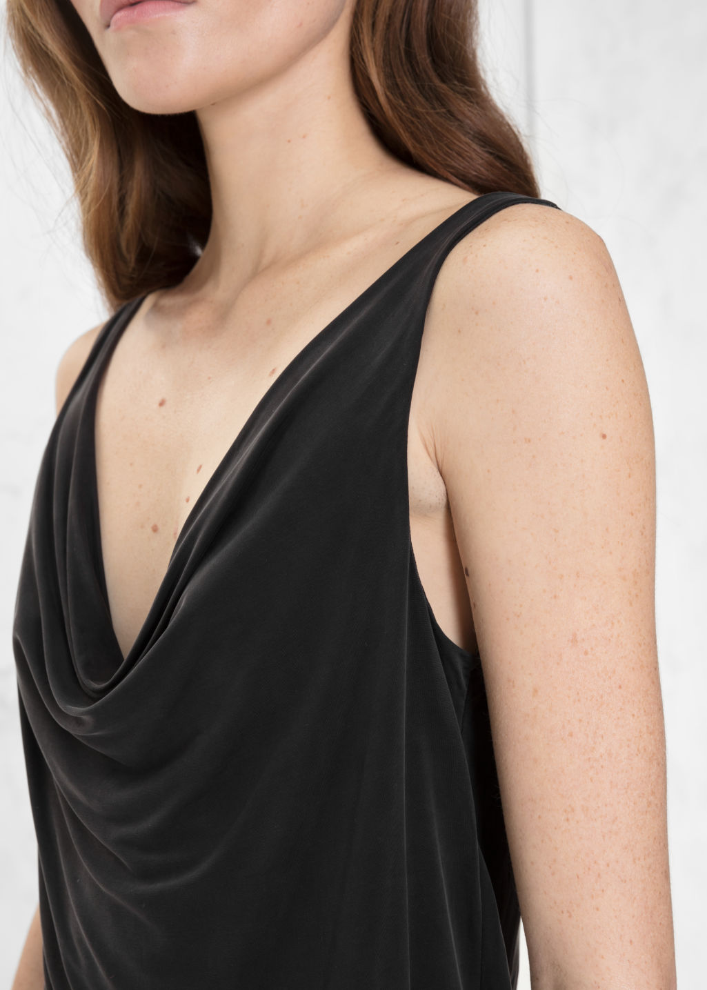 Detailed image of Stories drapey cupro top in black