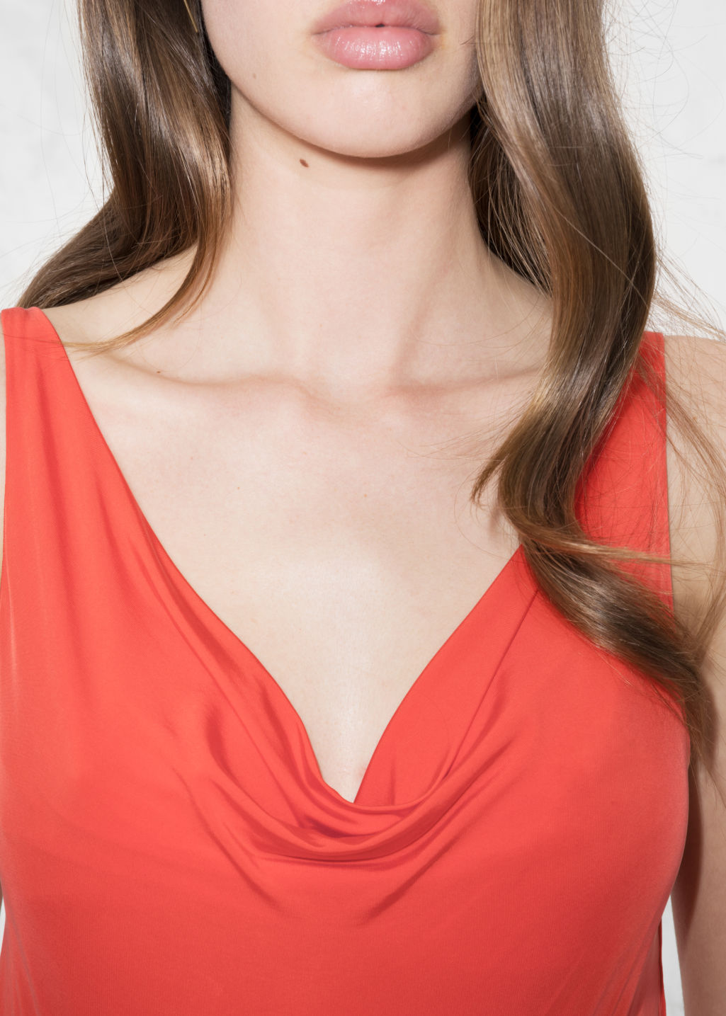 Detailed image of Stories drapey cupro top in orange