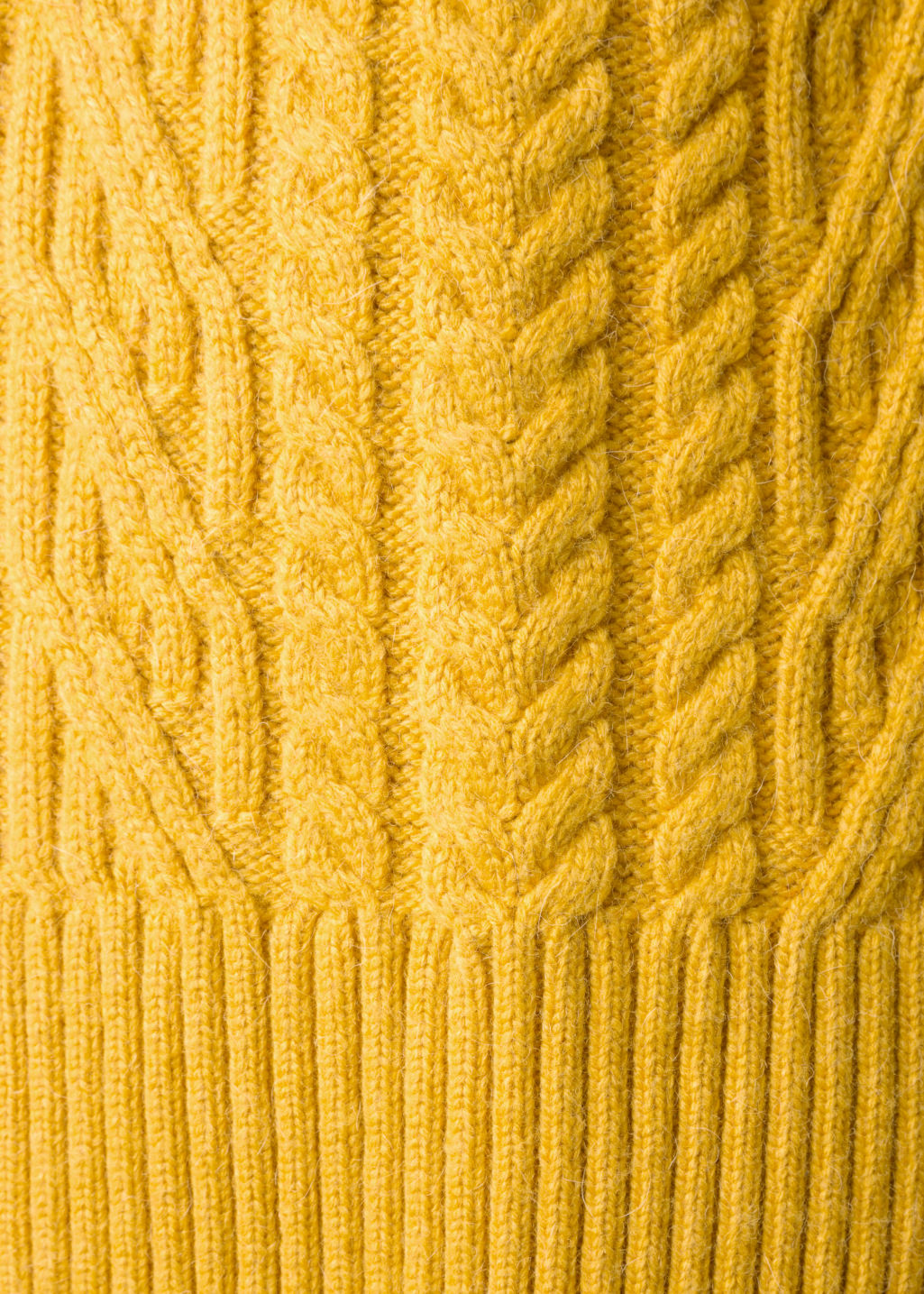 Detailed image of Stories cable knit jumper in yellow