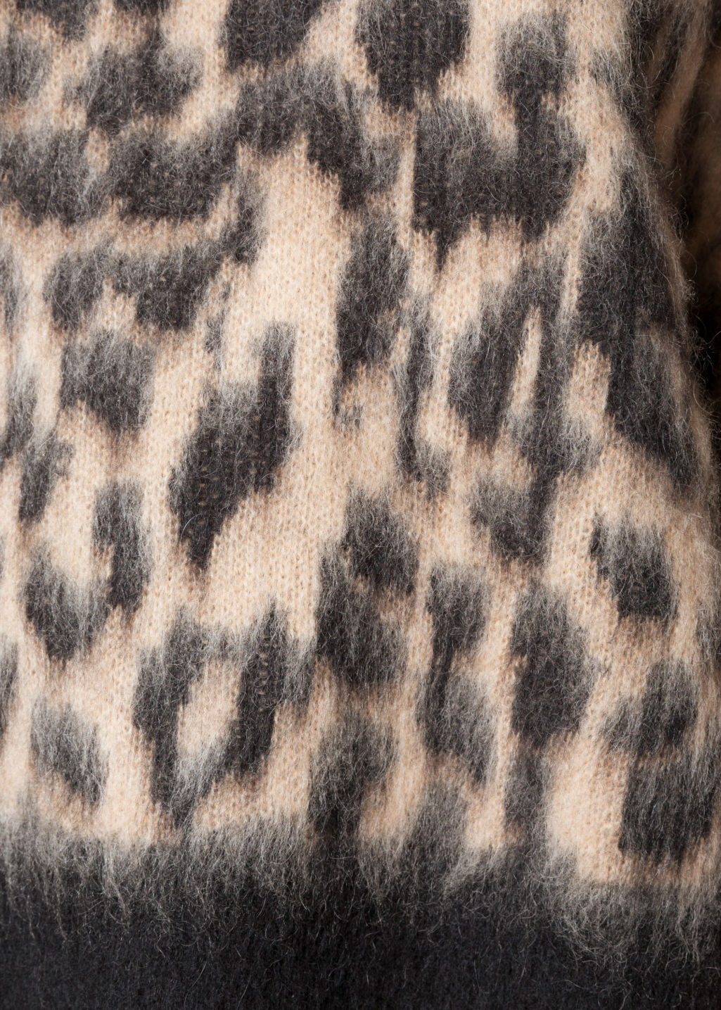 Detailed image of Stories fuzzy leopard jumper in beige