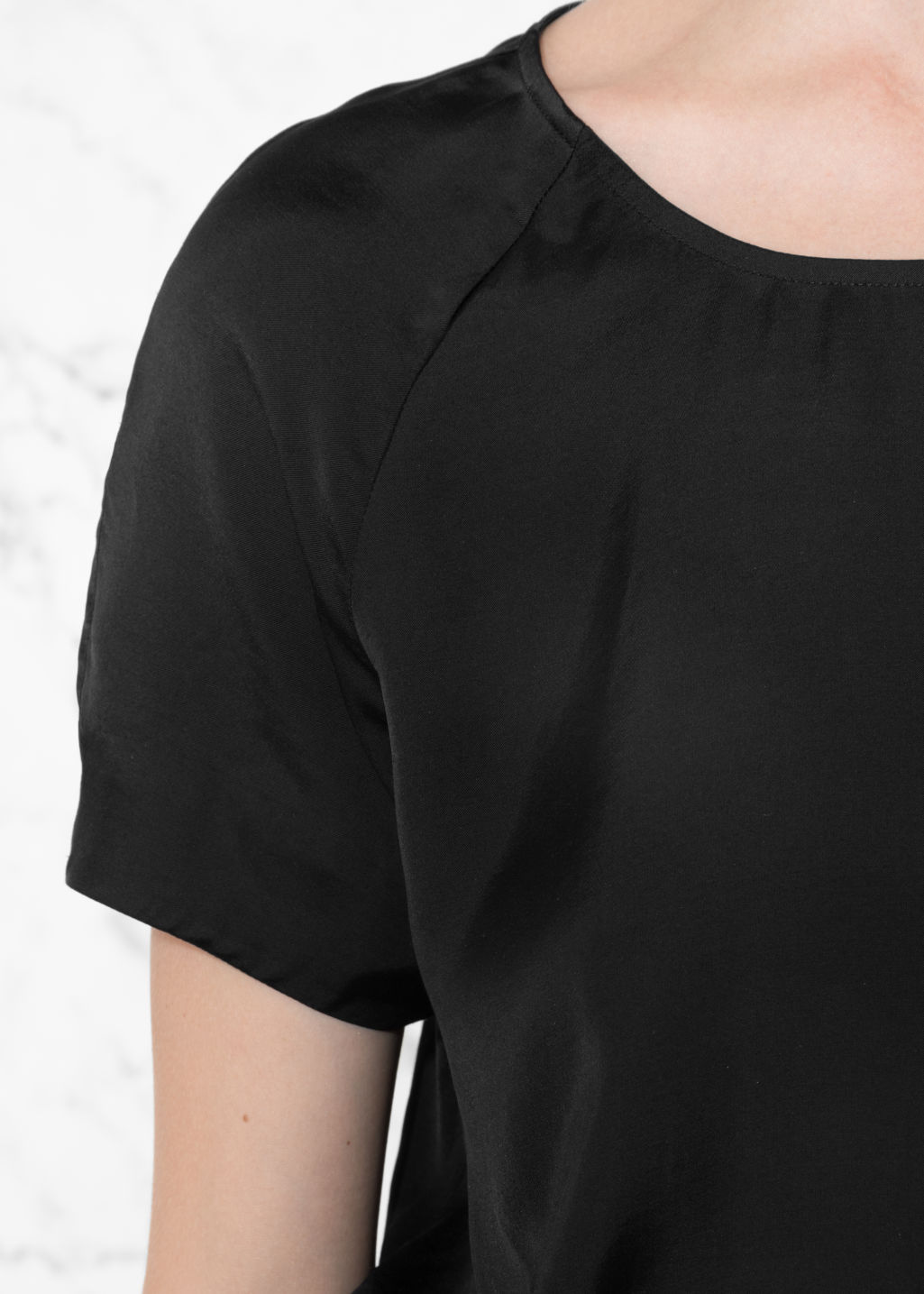 Detailed image of Stories voluminous crop blouse in black