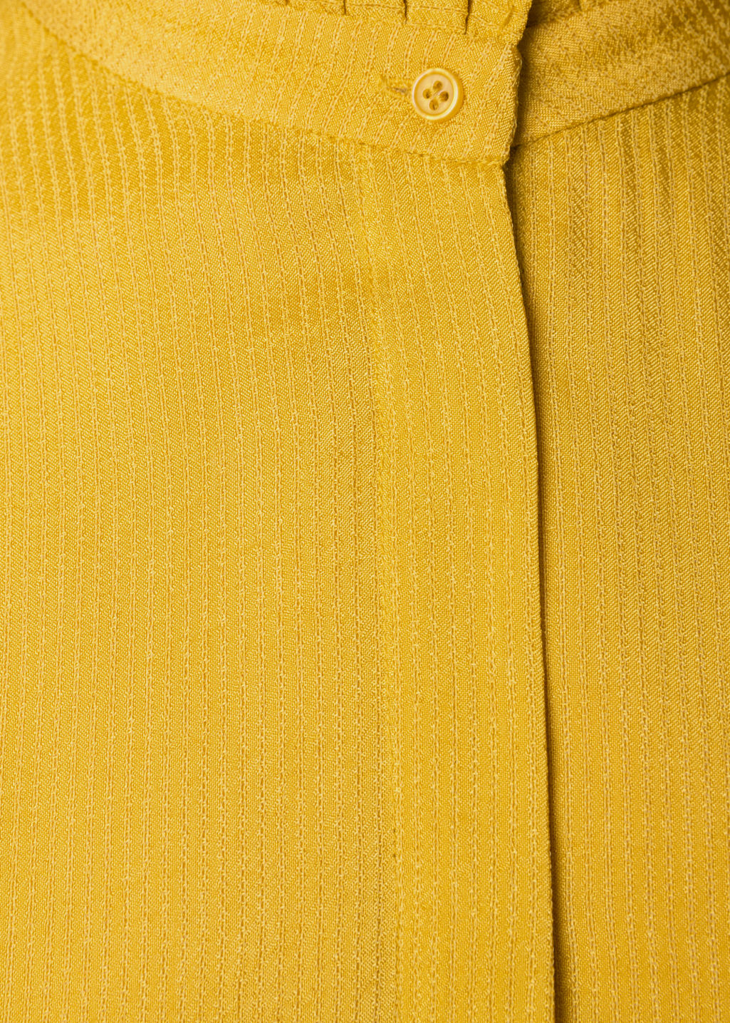 Detailed image of Stories pleat frill neck blouse in yellow