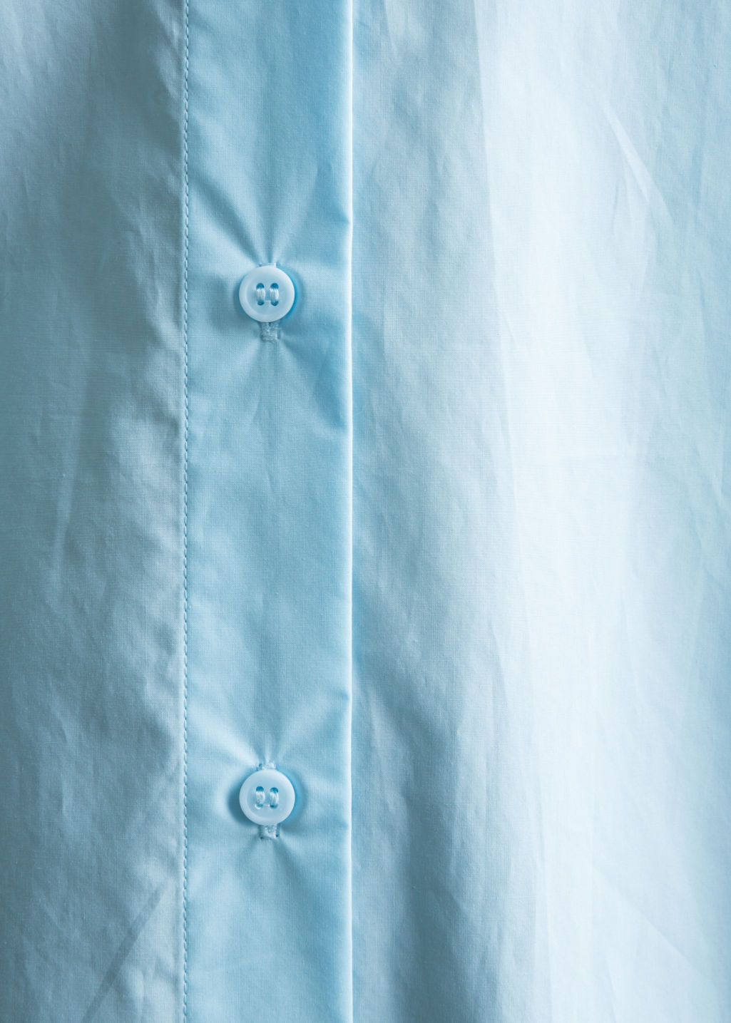 Detailed image of Stories relaxed fit cotton button-down in turquoise