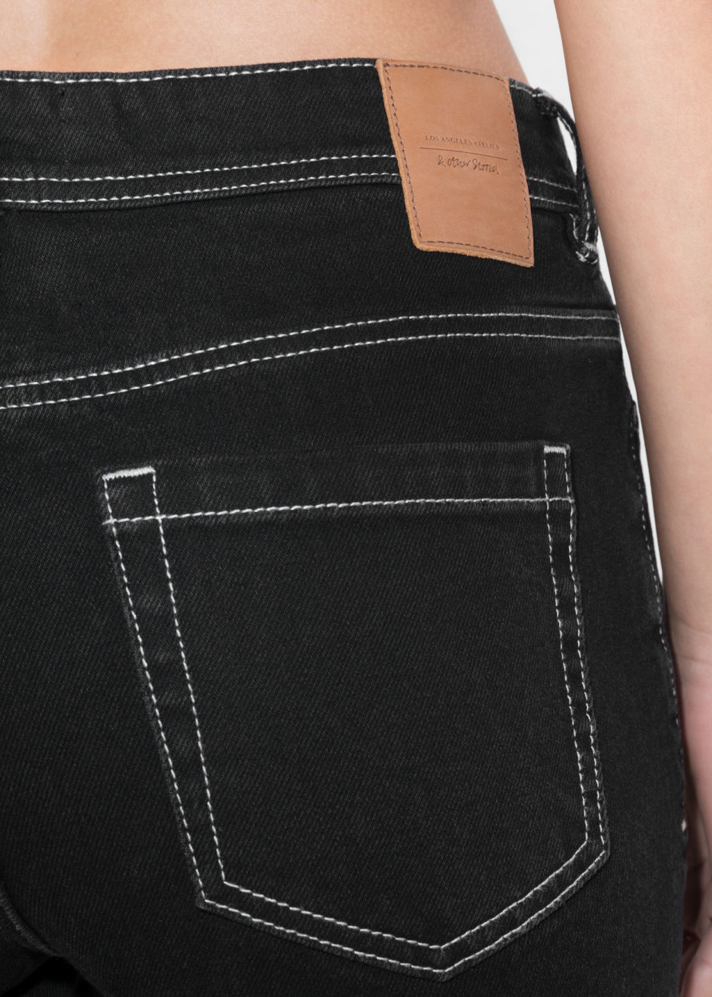 Detailed image of Stories cropped denim jeans in black
