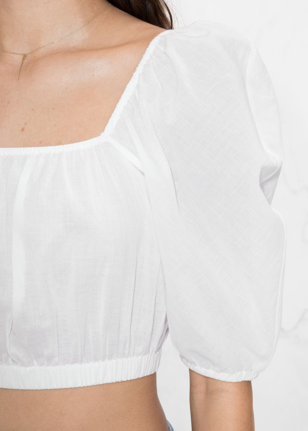 Detailed image of Stories voluminous crop blouse in white