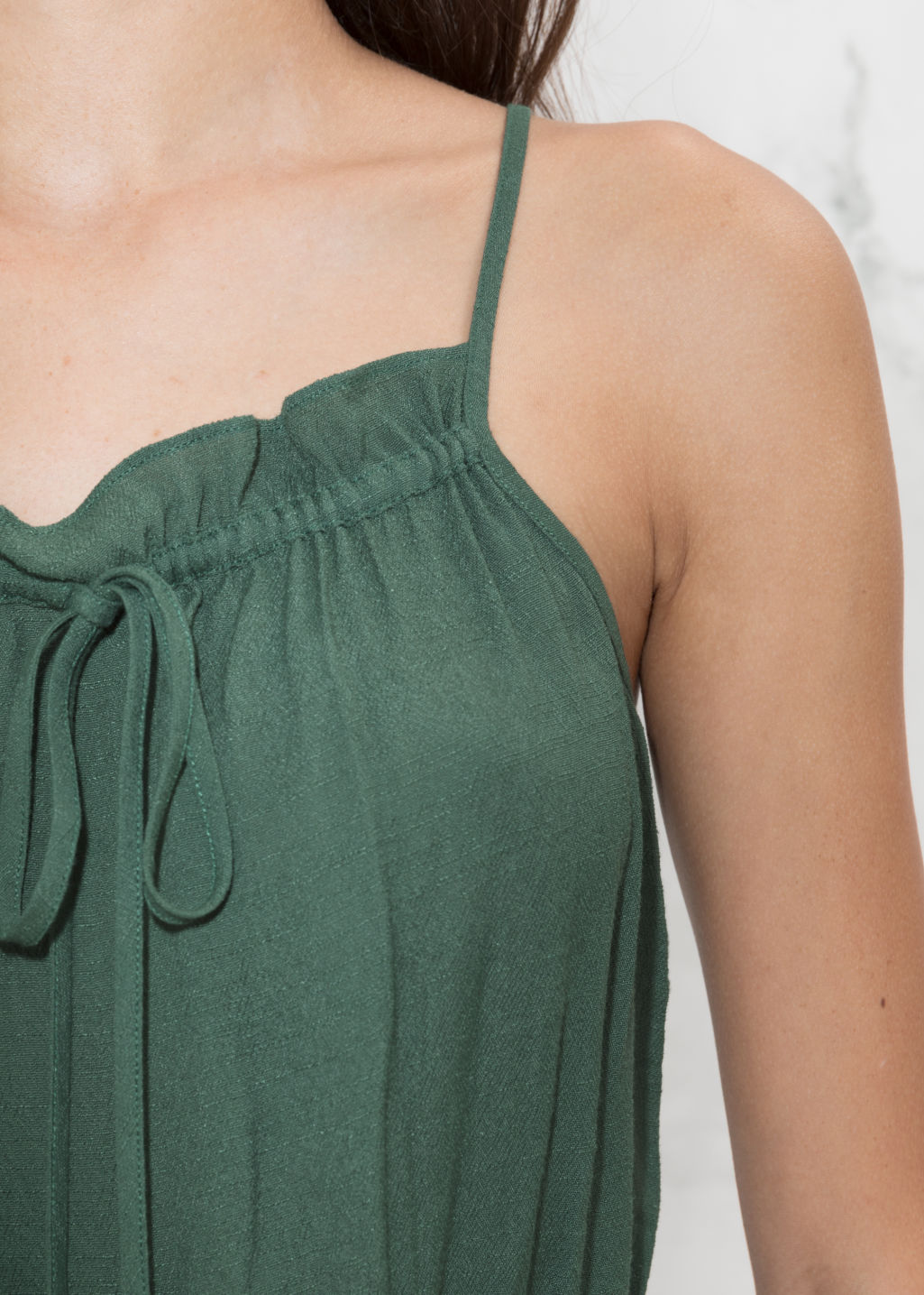 Detailed image of Stories gathered strap top in green