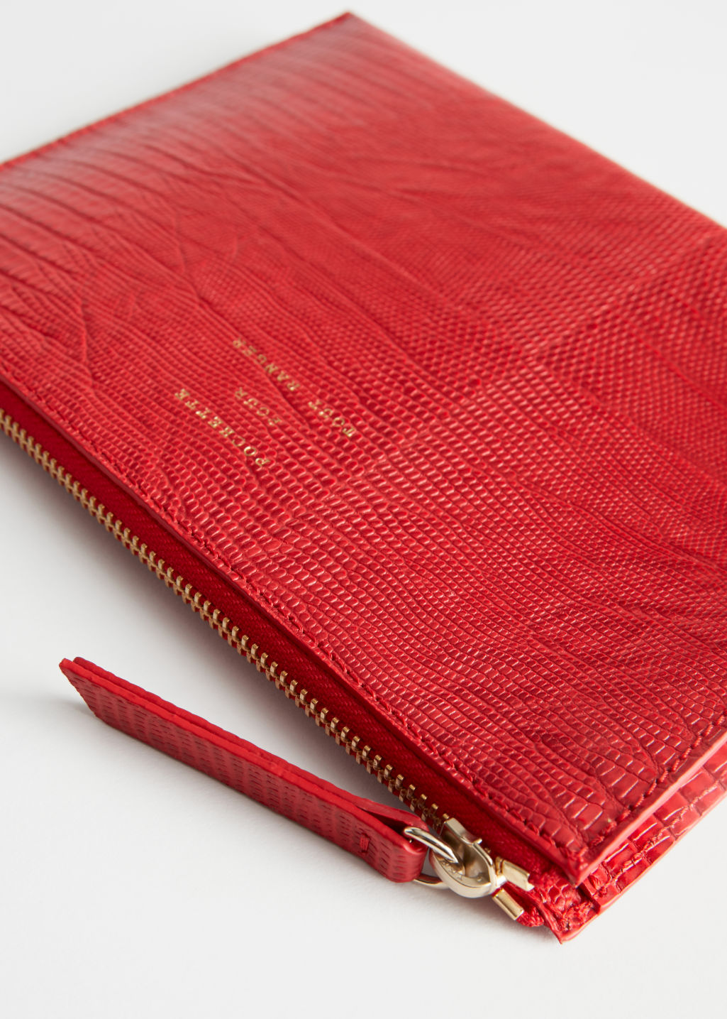 Detailed image of Stories zipped leather purse in red