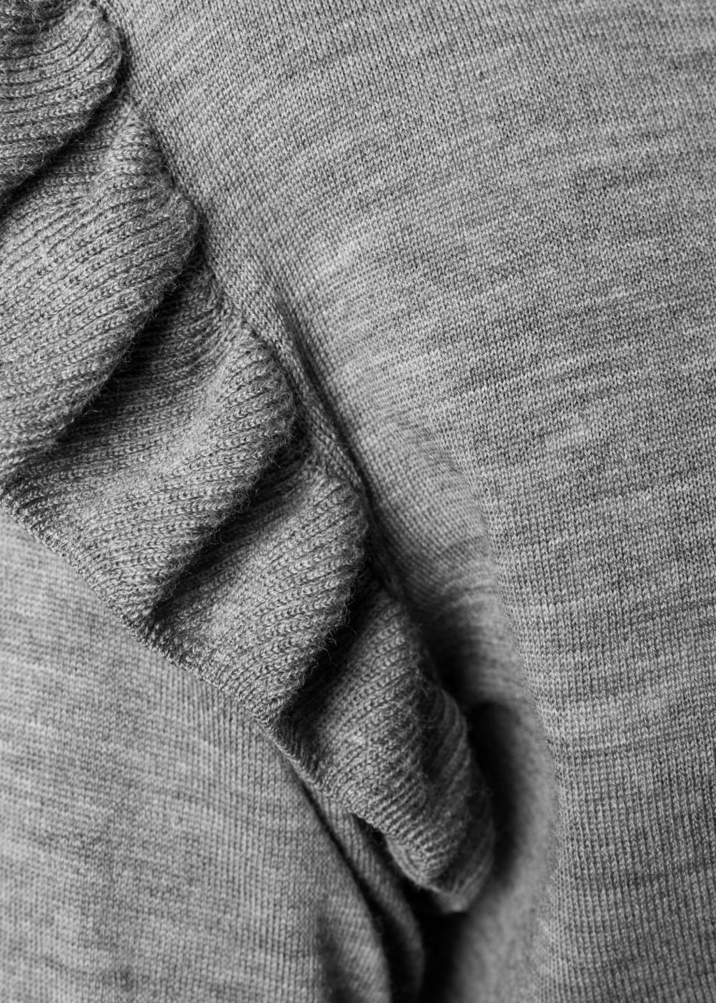 Detailed image of Stories frill merino wool sweater in grey
