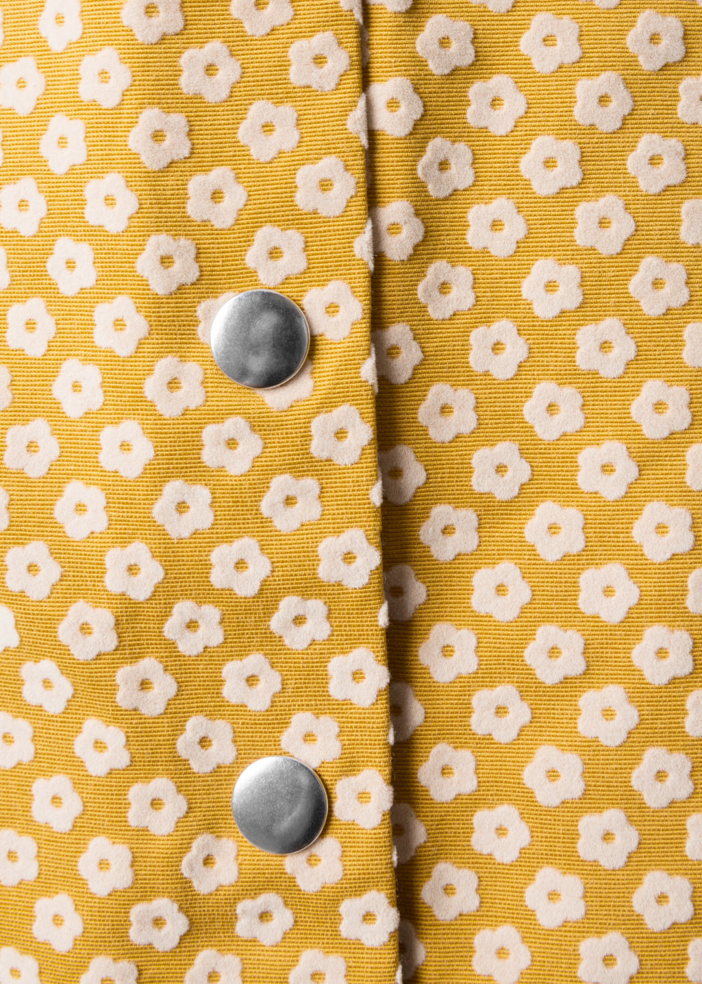 Detailed image of Stories mini skirt with button closure in yellow