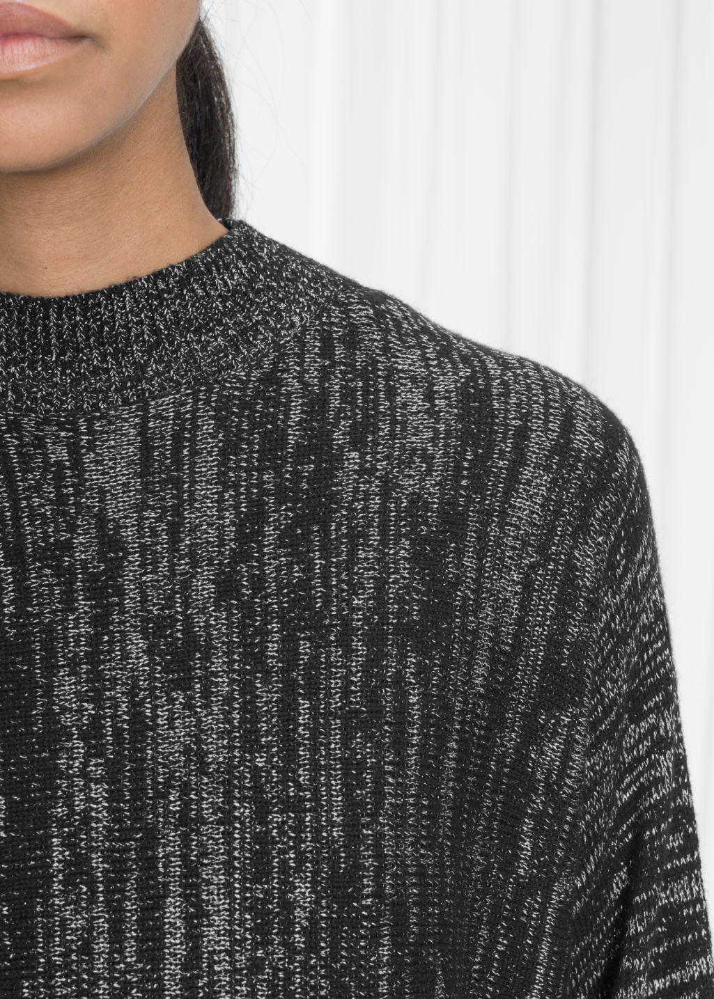Detailed image of Stories metallic melange sweater in black