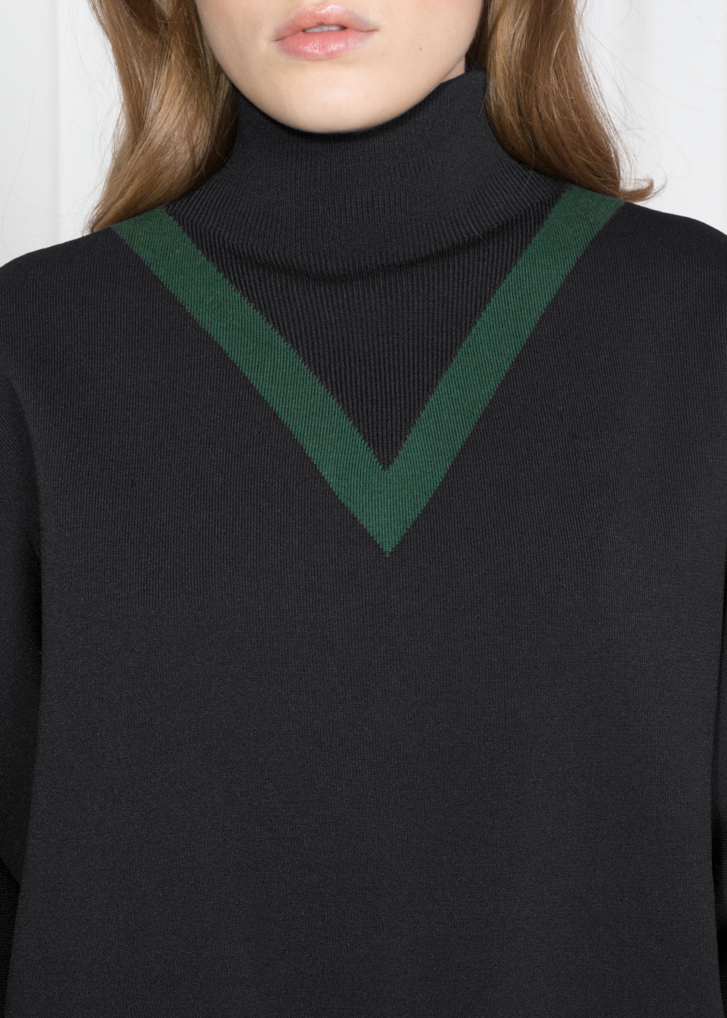 Detailed image of Stories high neck v-knit sweater in black