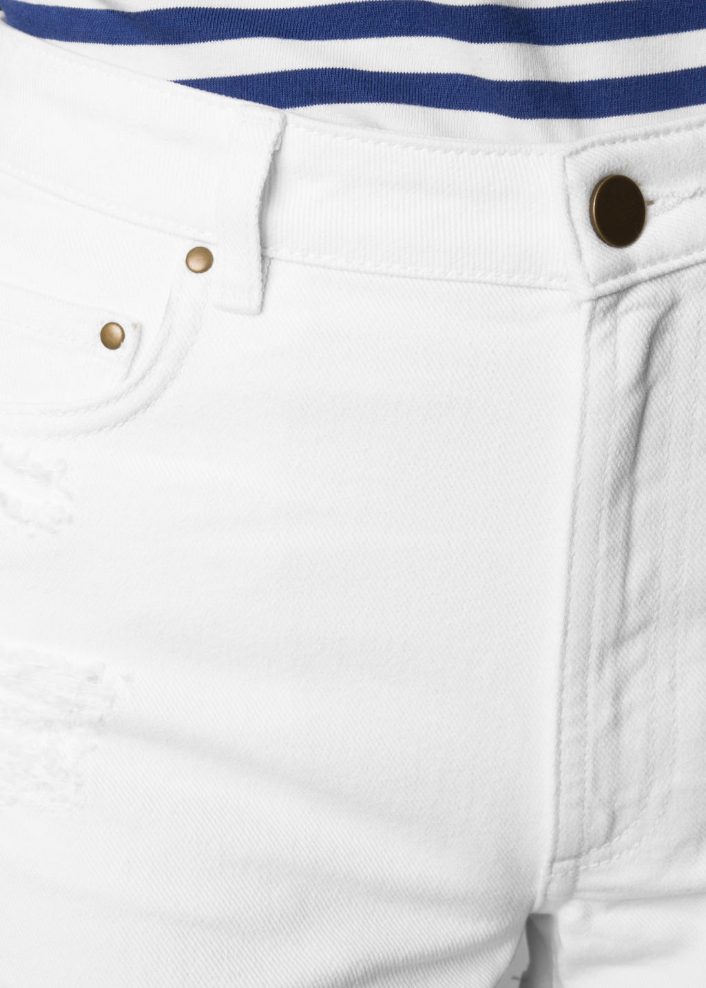 Detailed image of Stories shredded denim shorts in white