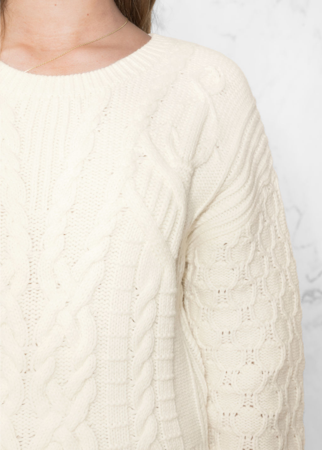 Detailed image of Stories cable knit sweater in white
