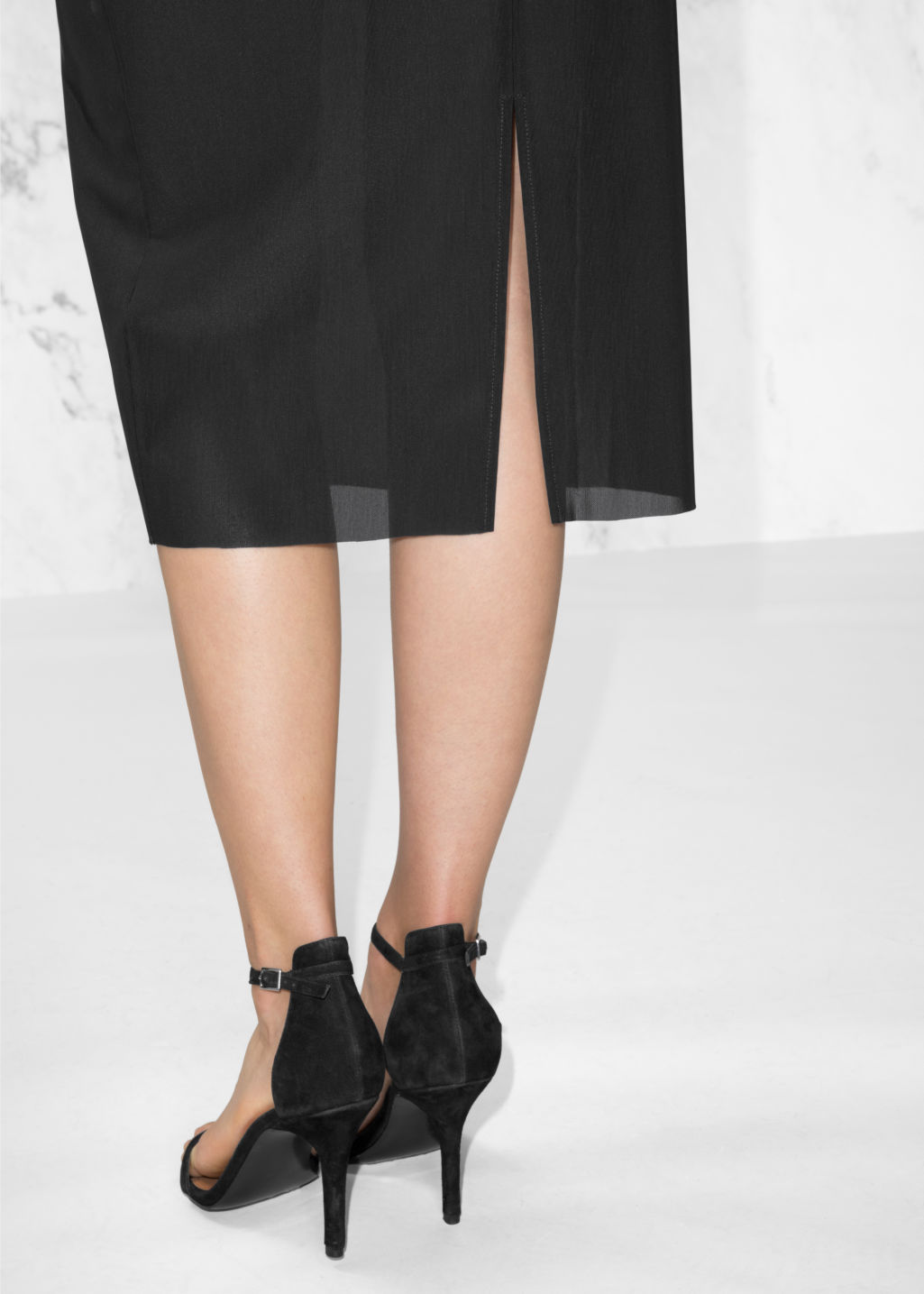Detailed image of Stories slit pencil skirt in black