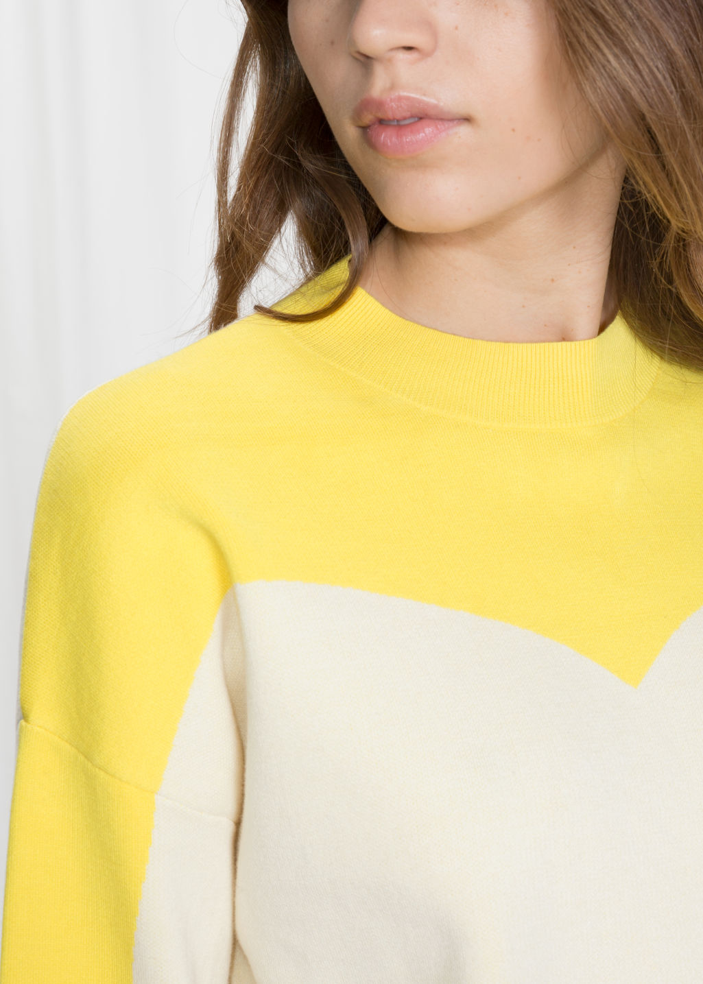 Detailed image of Stories colour blocking cotton sweater in white