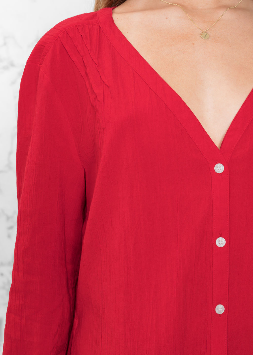Detailed image of Stories v-neck blouse in red