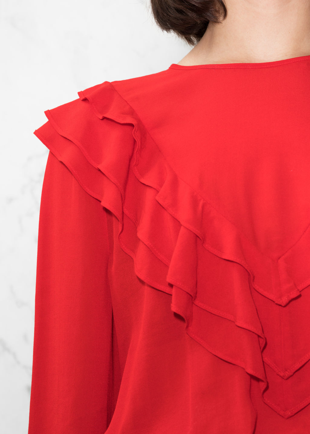 Detailed image of Stories ruffle blouse in red