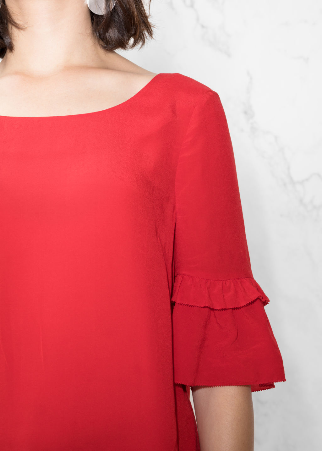 Detailed image of Stories ruffle sleeves blouse in red