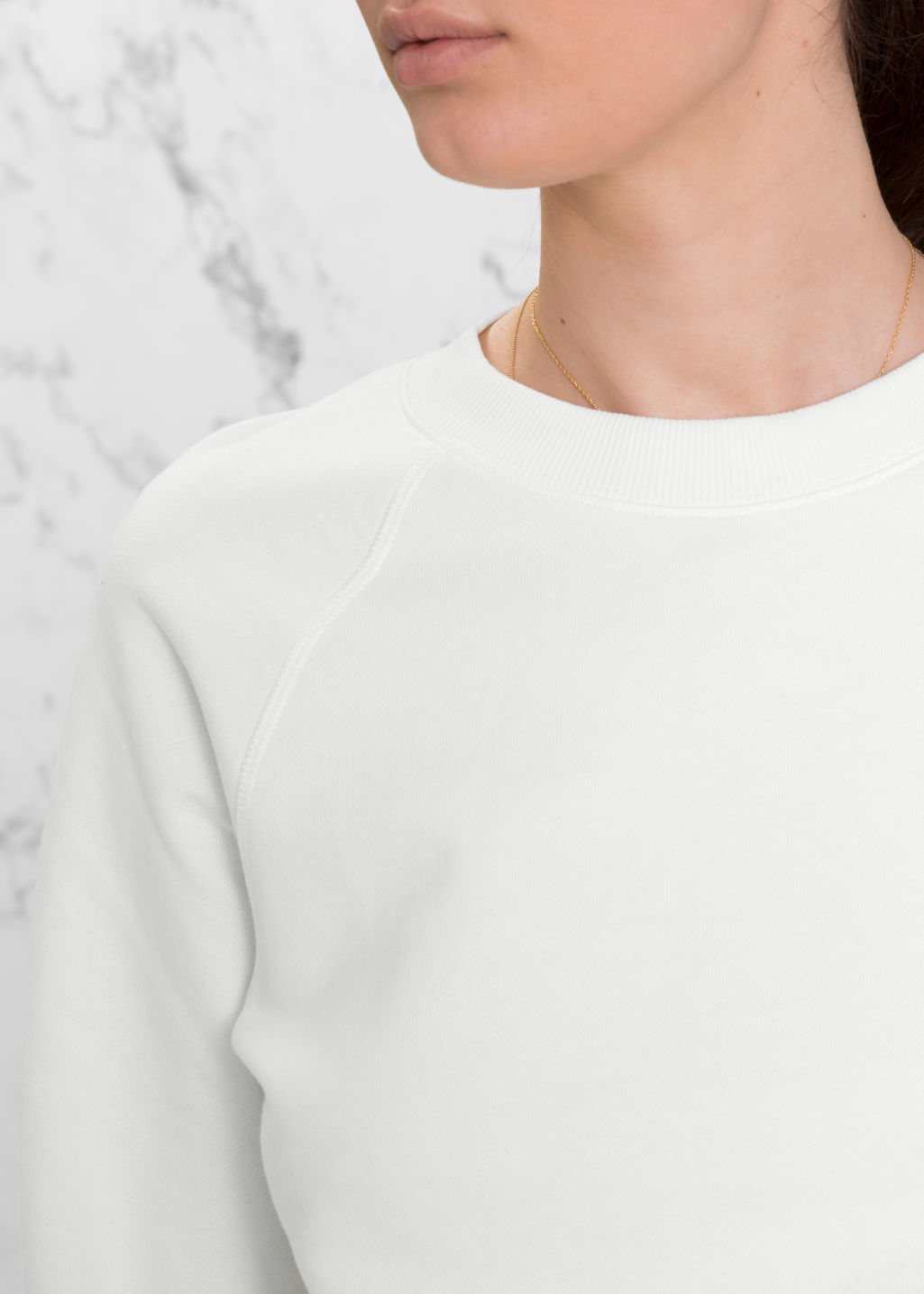 Detailed image of Stories raglan sleeve sweater in white