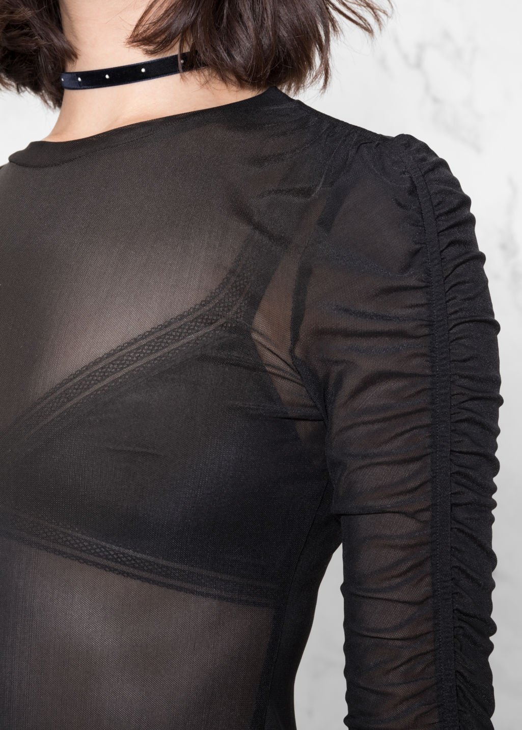 Detailed image of Stories gathered sleeve top in black