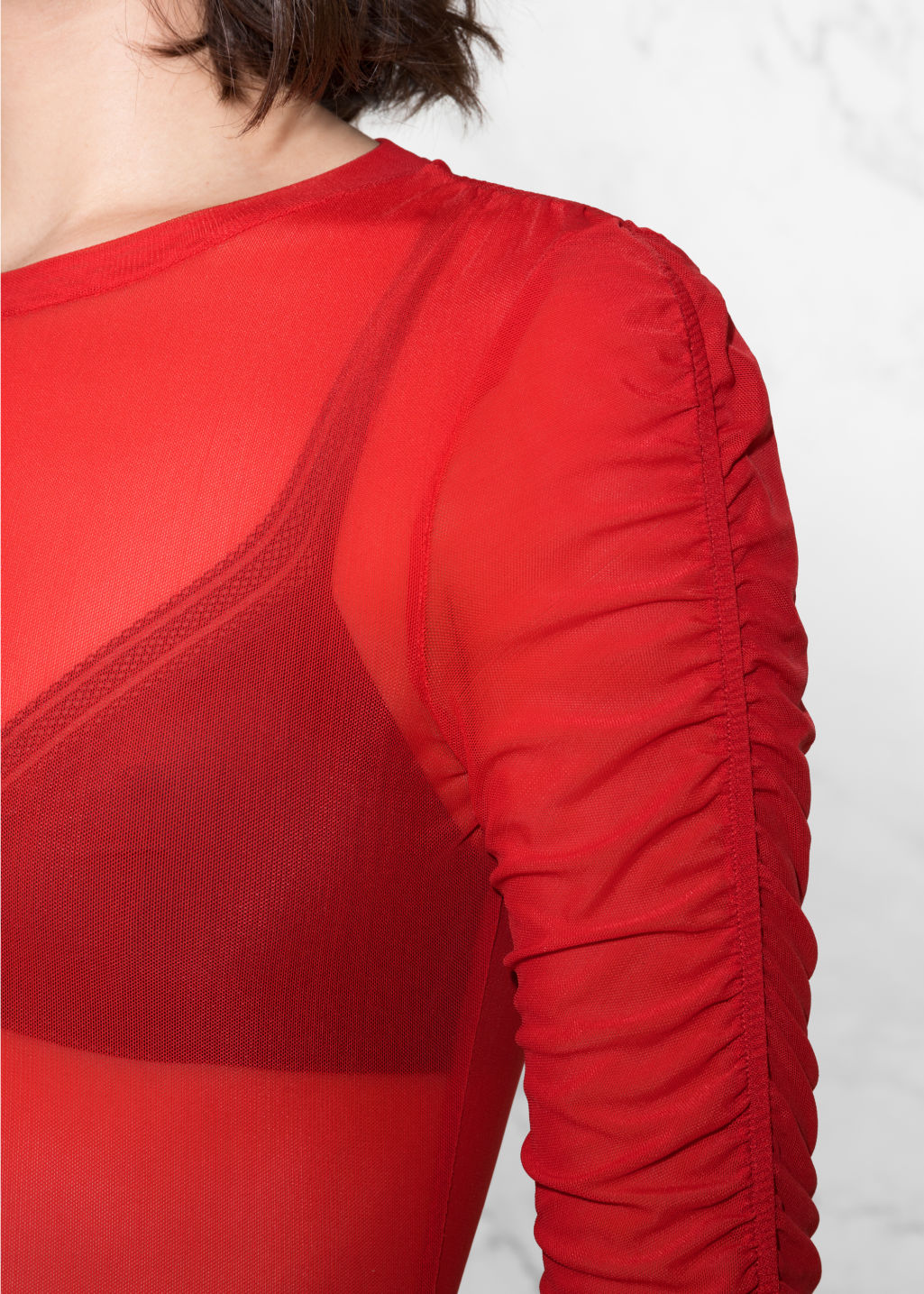 Detailed image of Stories gathered sleeve top in red