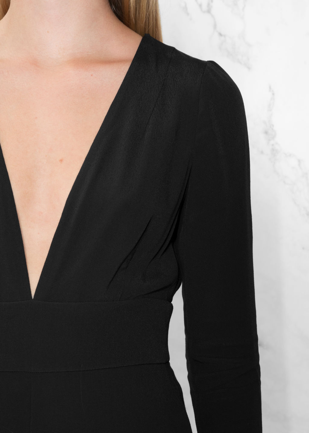 Detailed image of Stories deep v jumpsuit in black