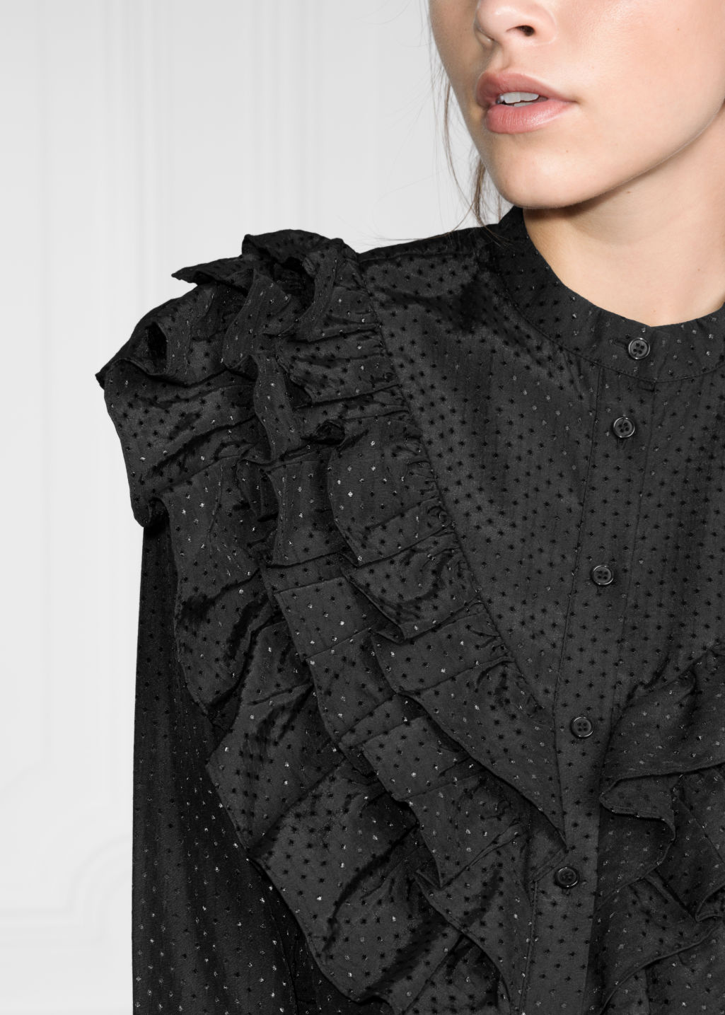 Detailed image of Stories ruffle blouse  in black