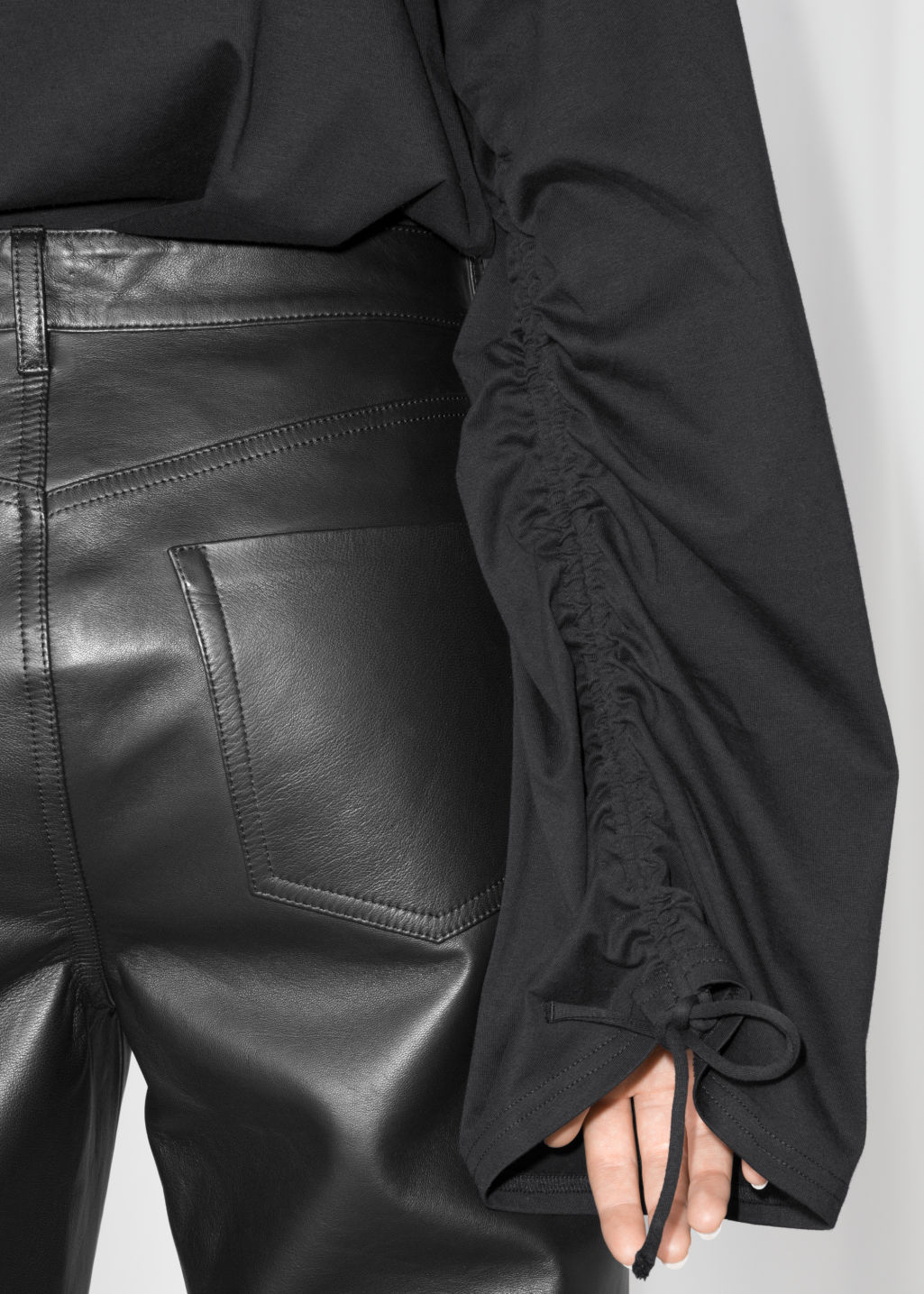 Detailed image of Stories drawstring sleeves top in black