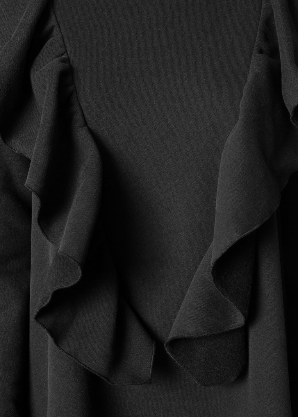 Detailed image of Stories oversized frill dress in black