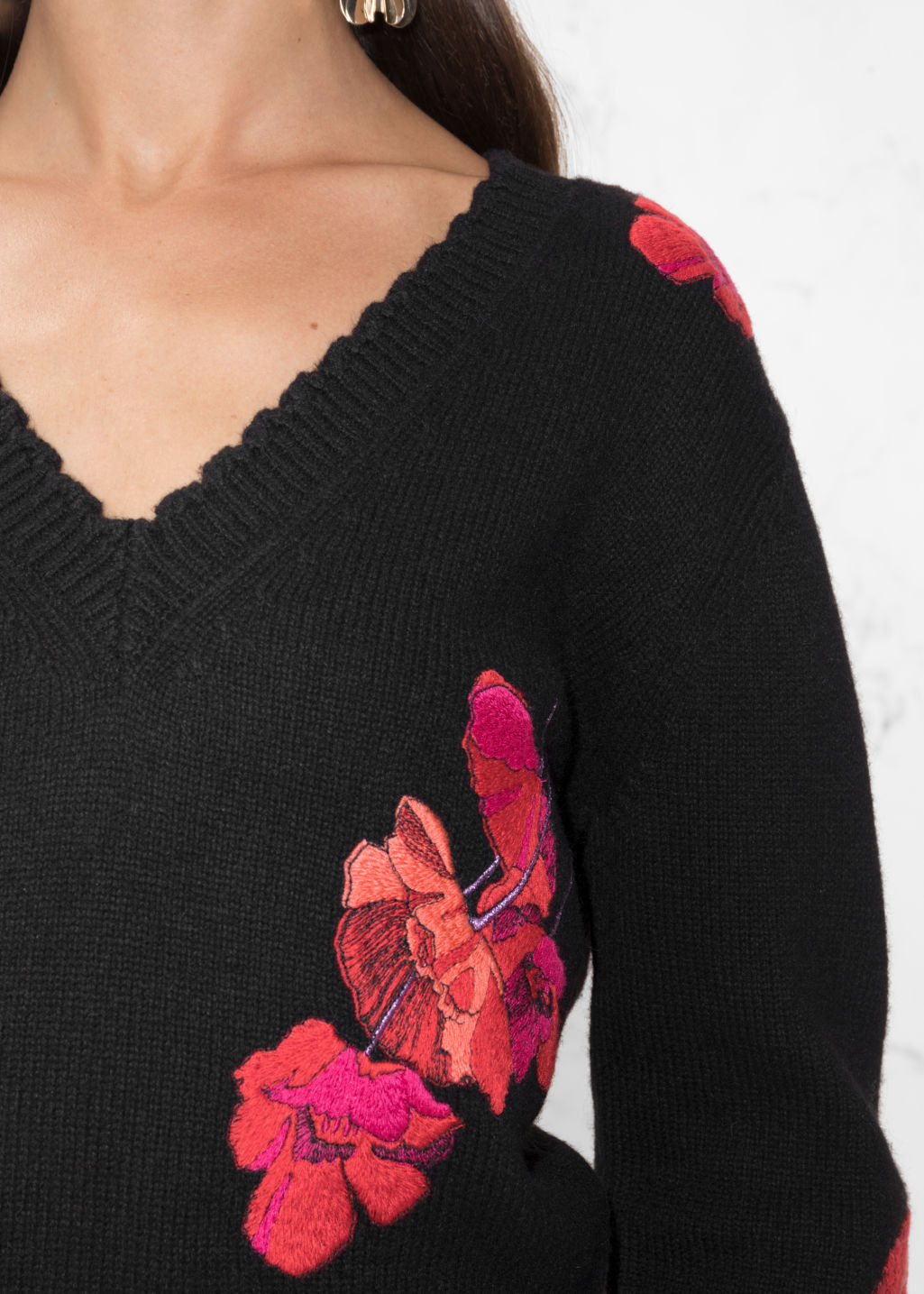 Detailed image of Stories knit embroidery sweater in black