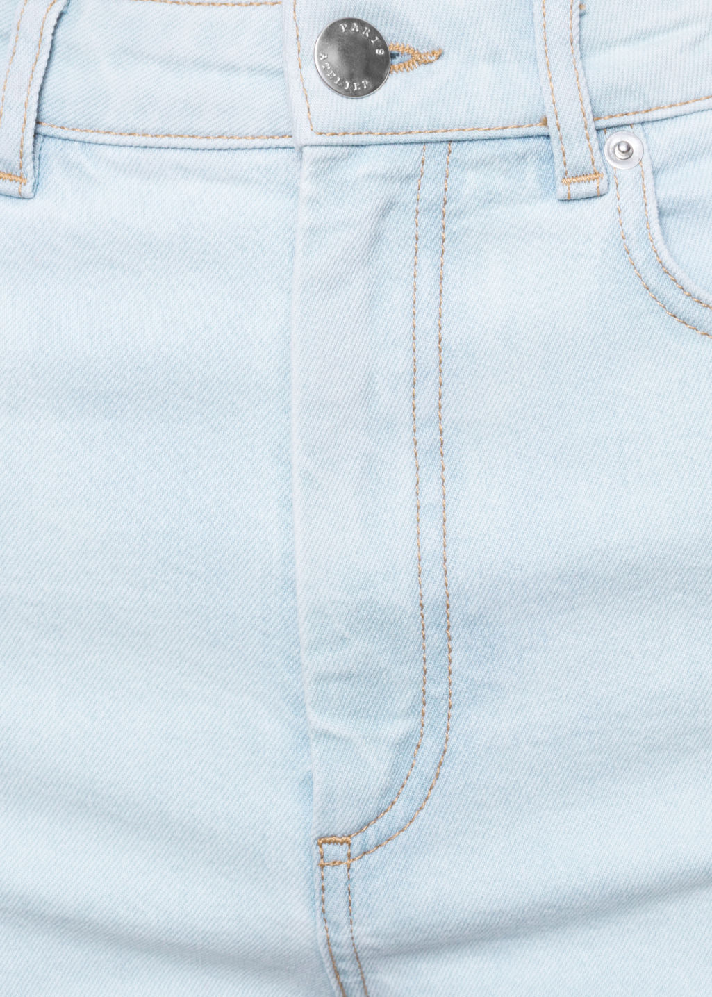 Detailed image of Stories light wash denim jeans in blue