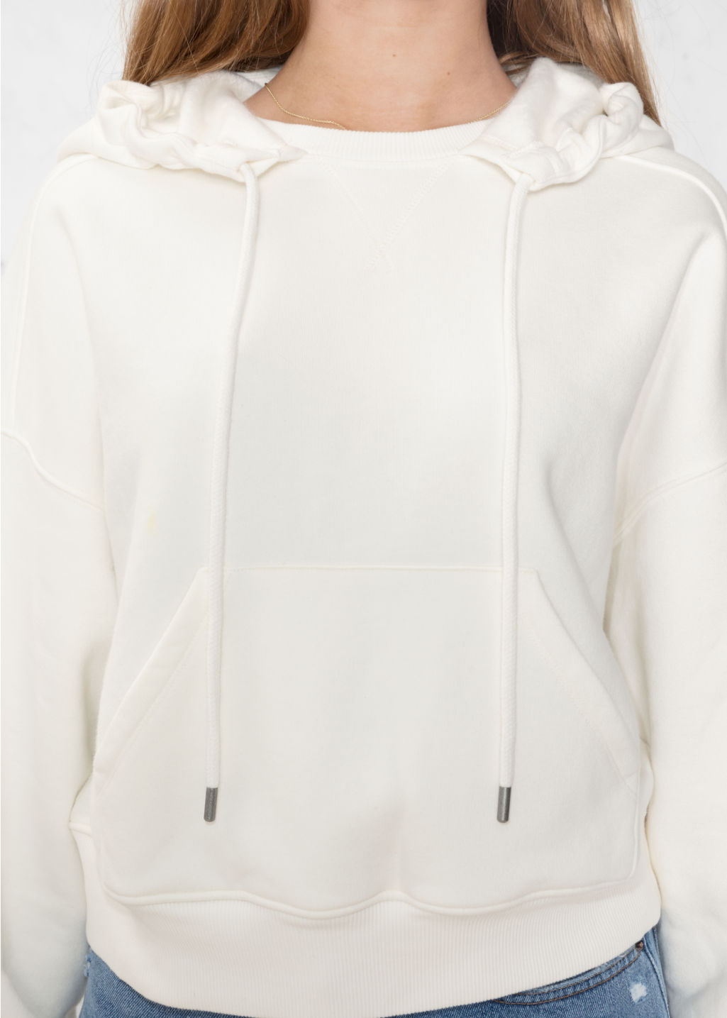 Detailed image of Stories patch pocket hoodie in white