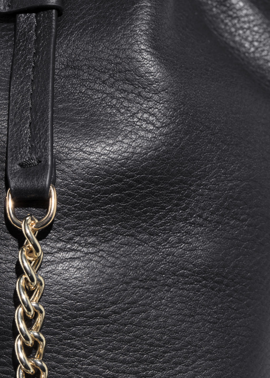 Detailed image of Stories chain strap bucket bag in black