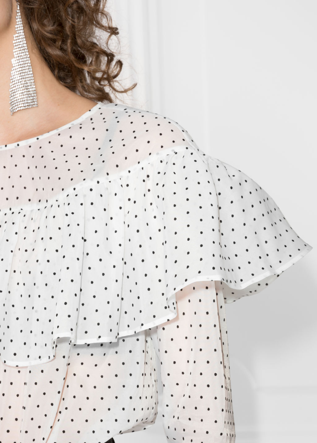 Detailed image of Stories polka-dot frill blouse in white