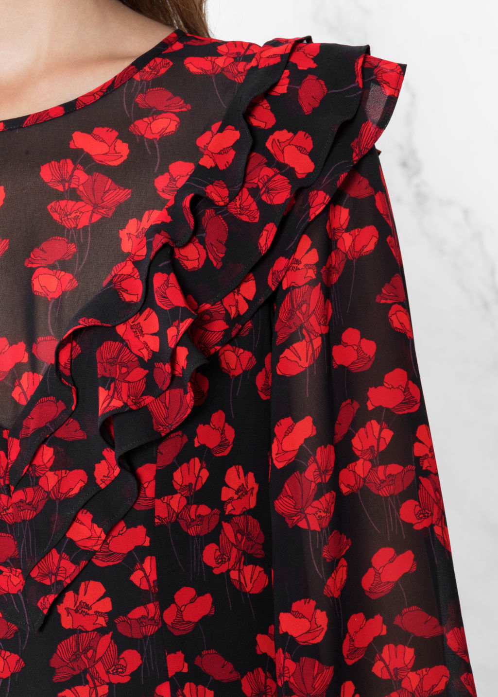 Detailed image of Stories poppy print dress in black
