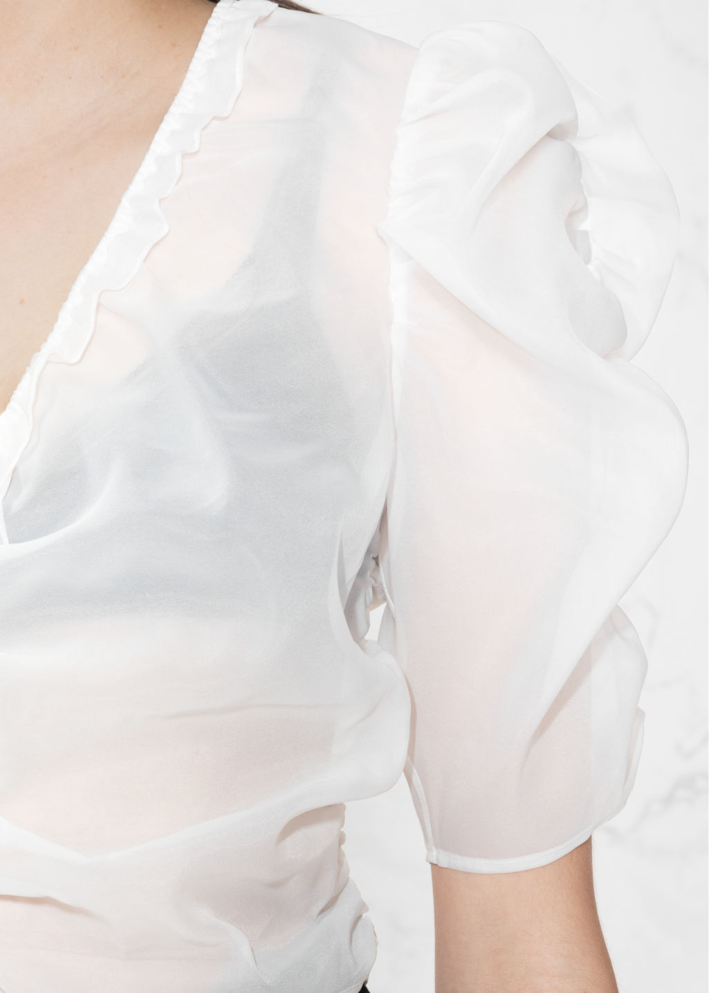 Detailed image of Stories sheer puff shoulder blouse in white