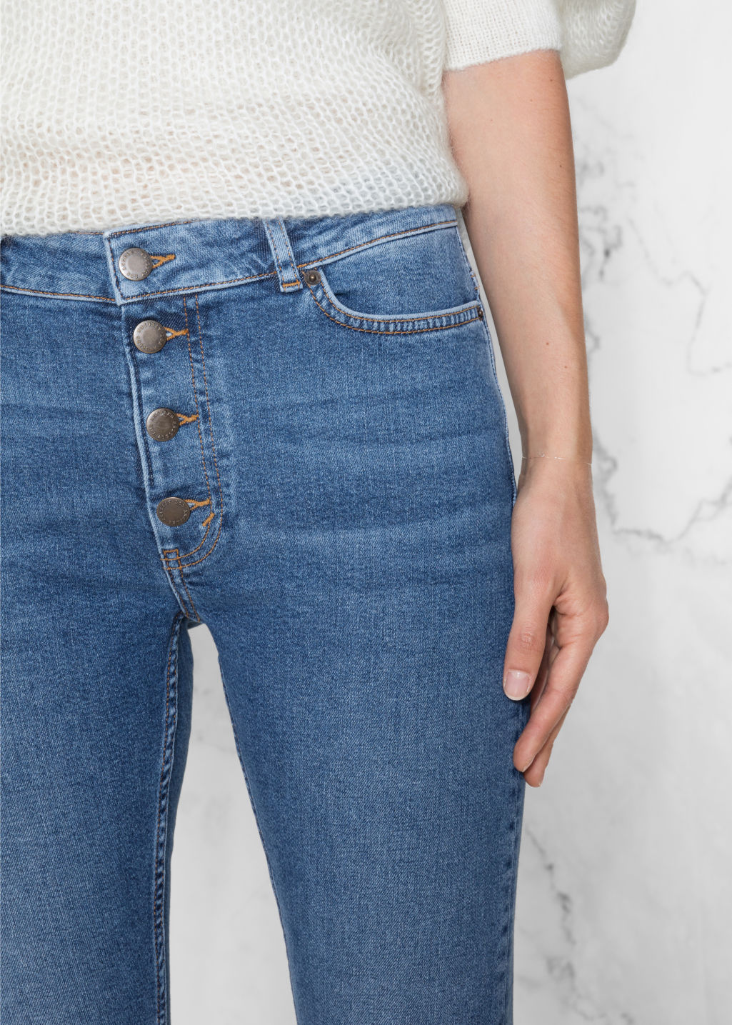 Detailed image of Stories ultra slim fit button fly denim in blue