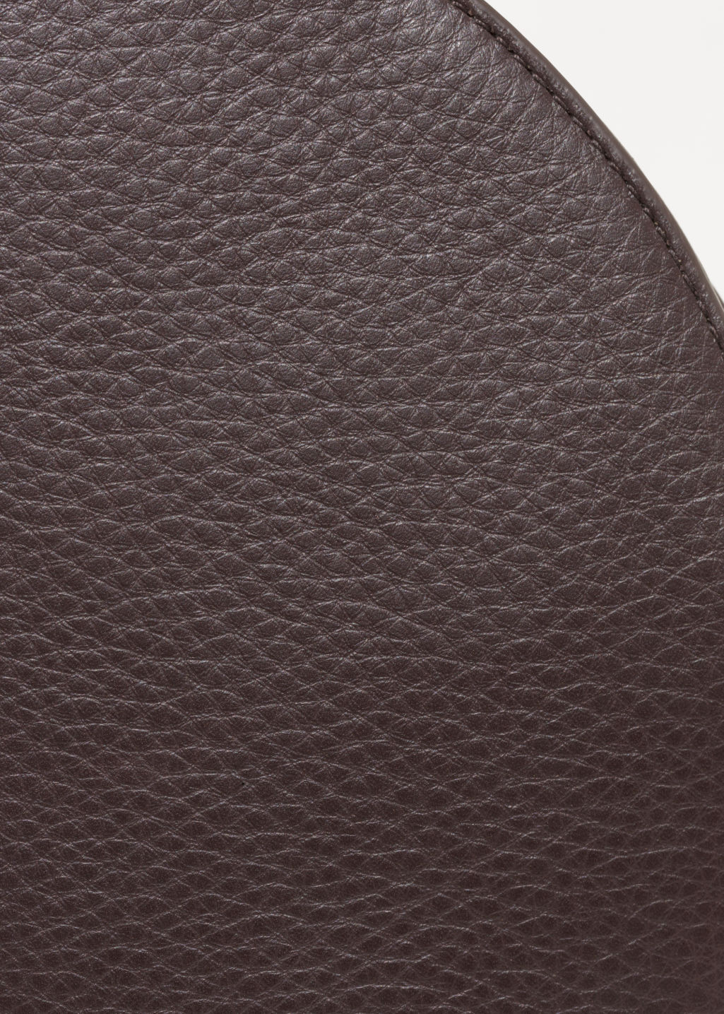 Detailed image of Stories round leather crossover in red